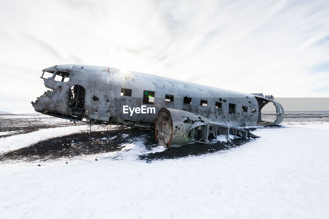 ABANDONED AIRPLANE ON SNOW LAND