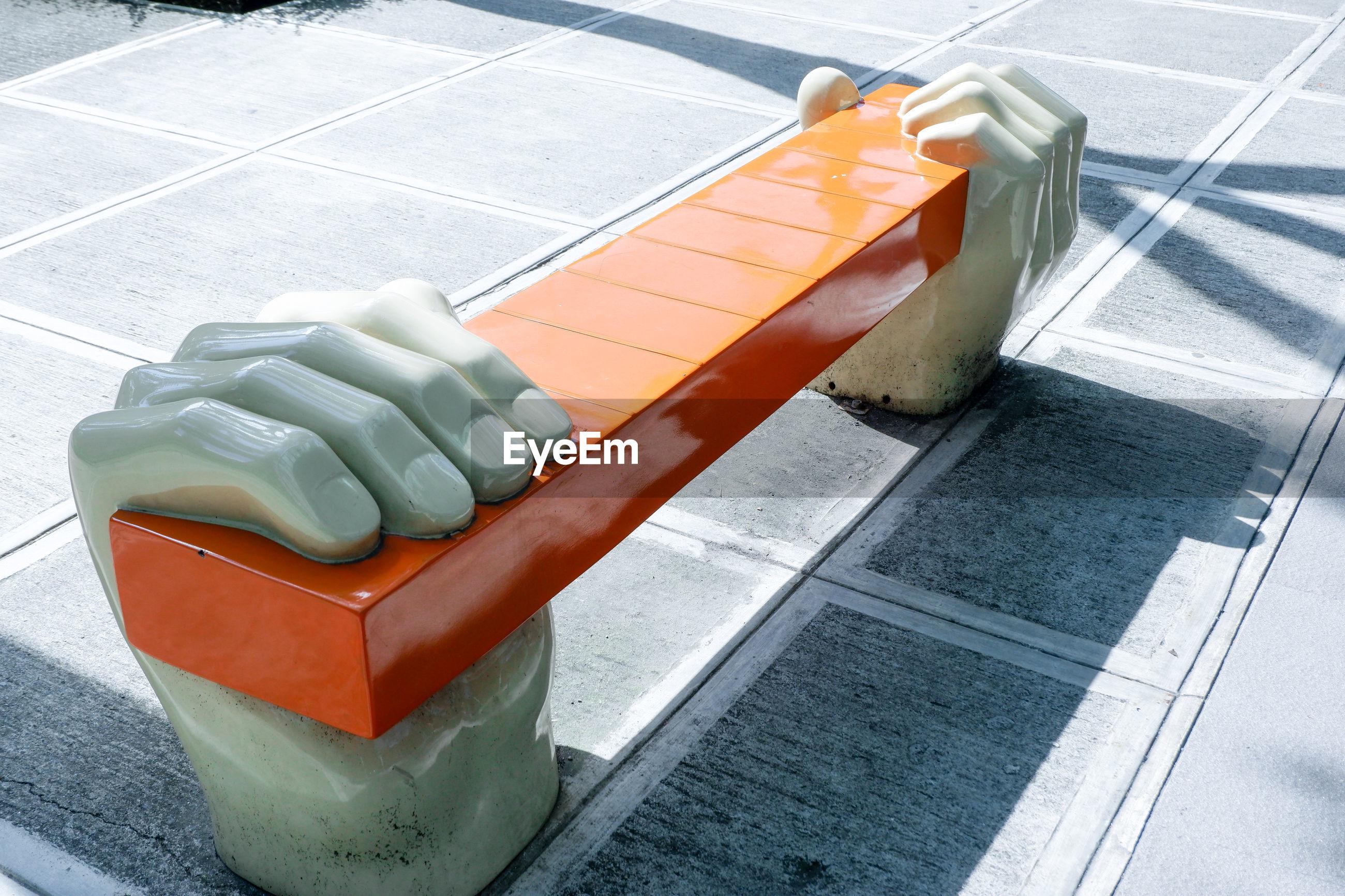 Creative hand sitting bench