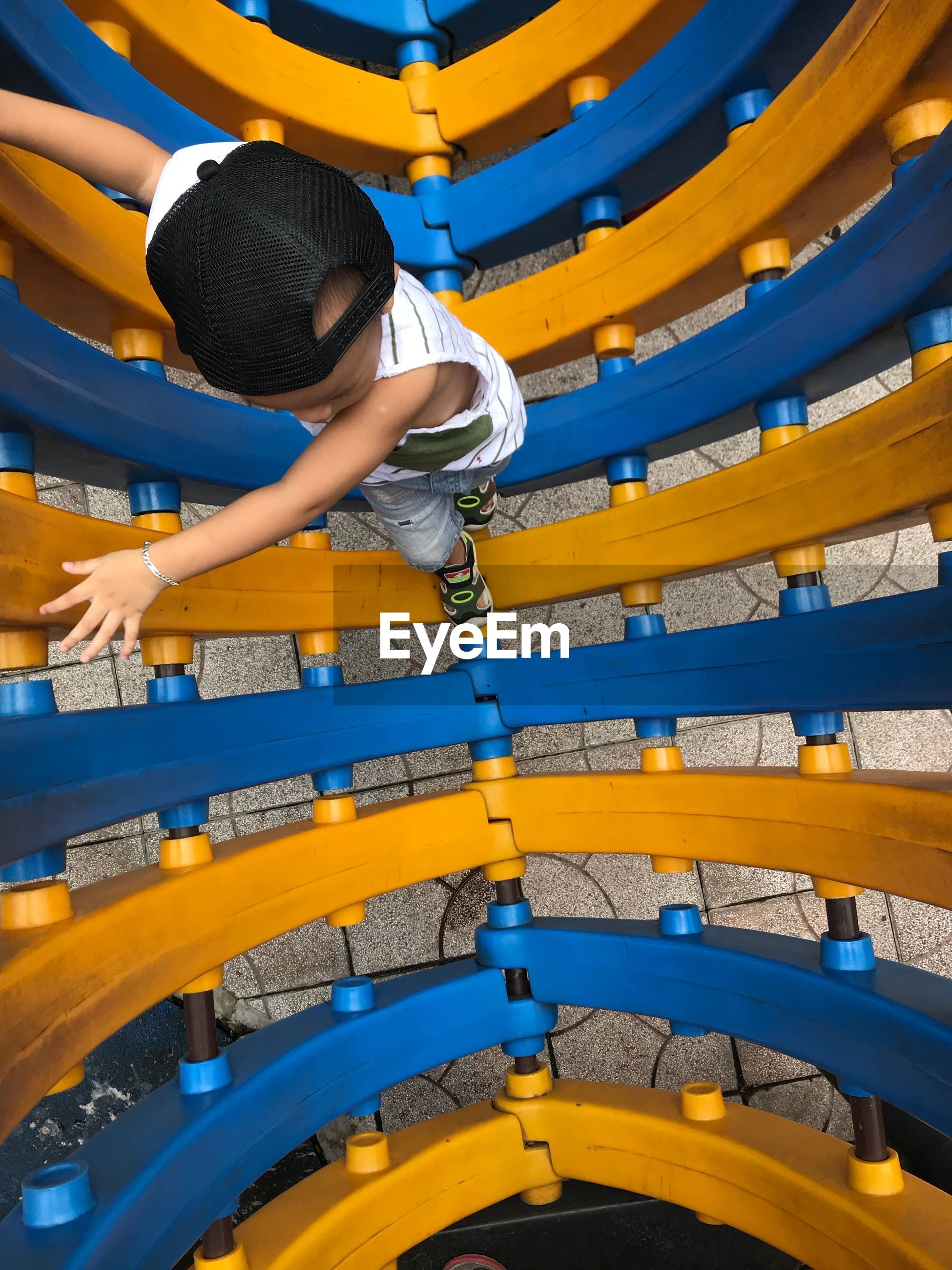 High angle view of boy playing at park
