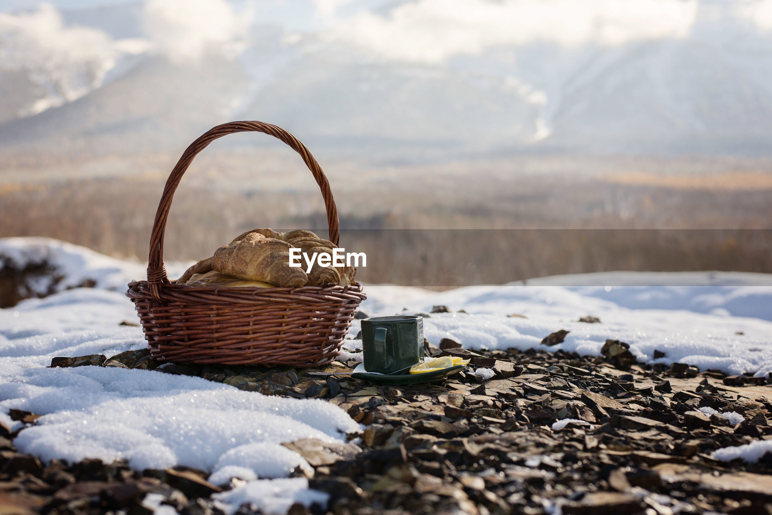 Croissant and tea on field