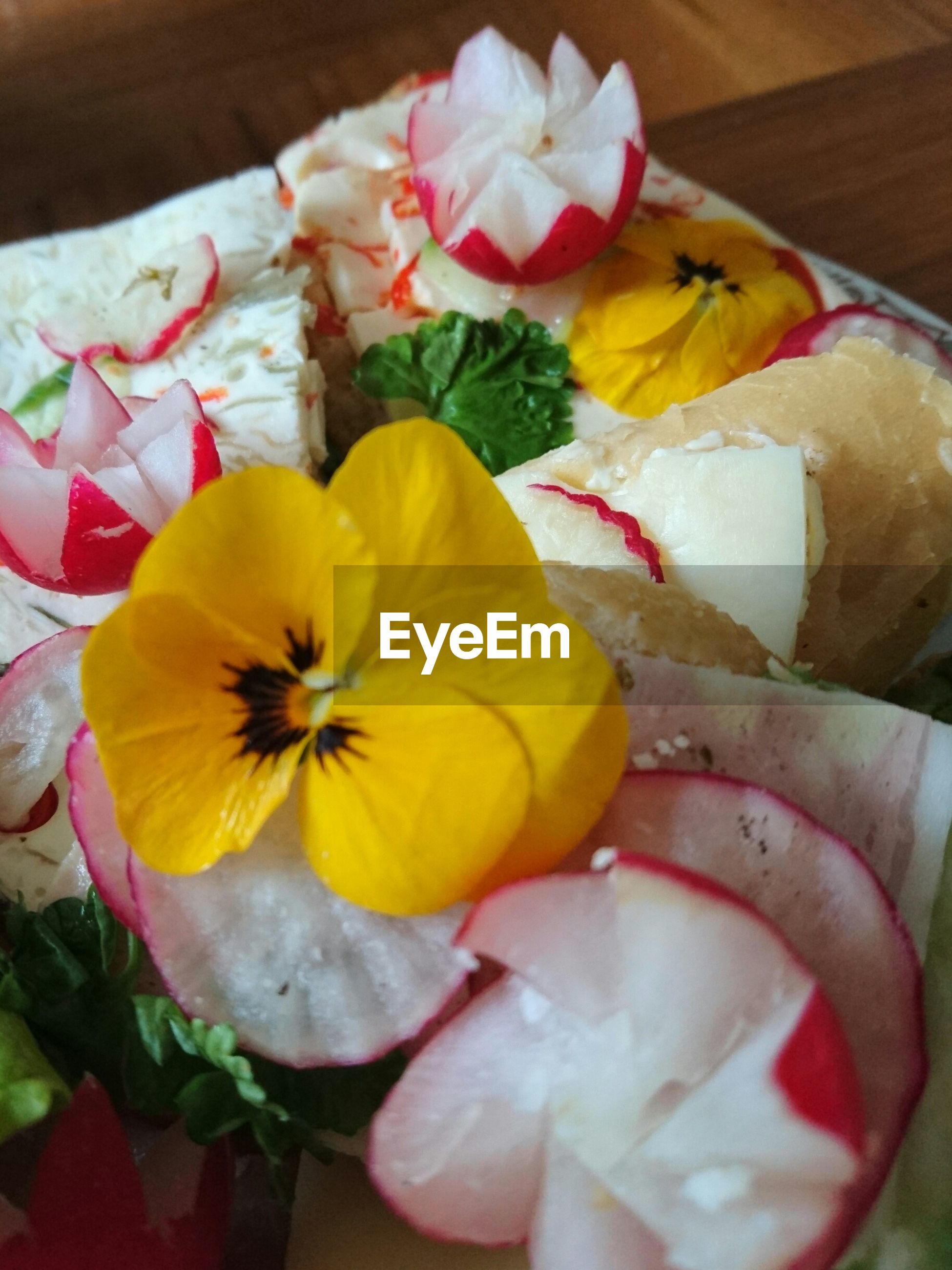 freshness, flower, indoors, petal, still life, table, close-up, high angle view, flower head, multi colored, yellow, pink color, variation, sweet food, food, food and drink, fragility, no people, dessert, decoration