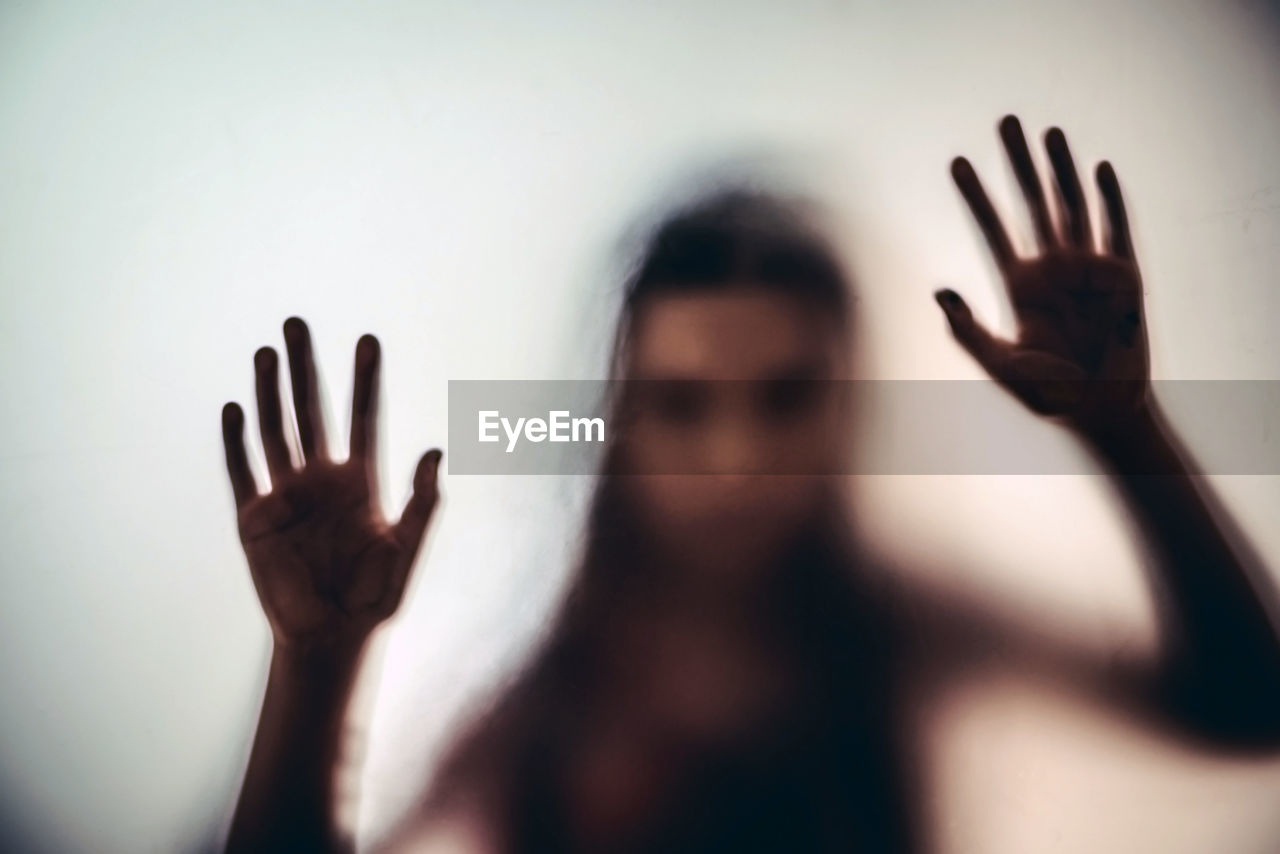 Girl Seen Through Window