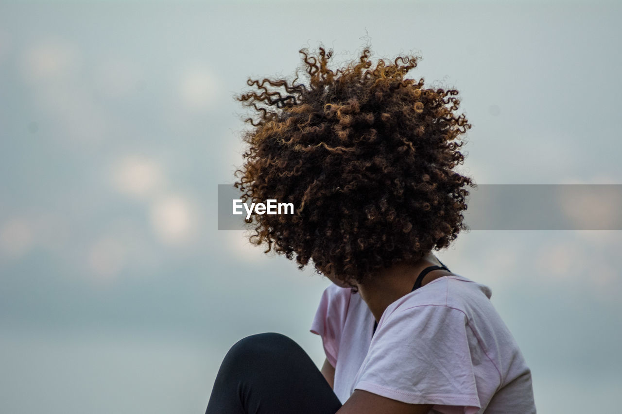 Side View Of Woman With Curly Hair