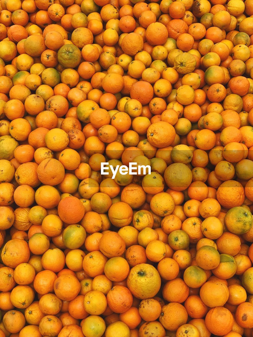 full frame, food, food and drink, backgrounds, healthy eating, freshness, abundance, fruit, large group of objects, wellbeing, no people, market, citrus fruit, orange color, market stall, still life, retail, high angle view, close-up, yellow, orange