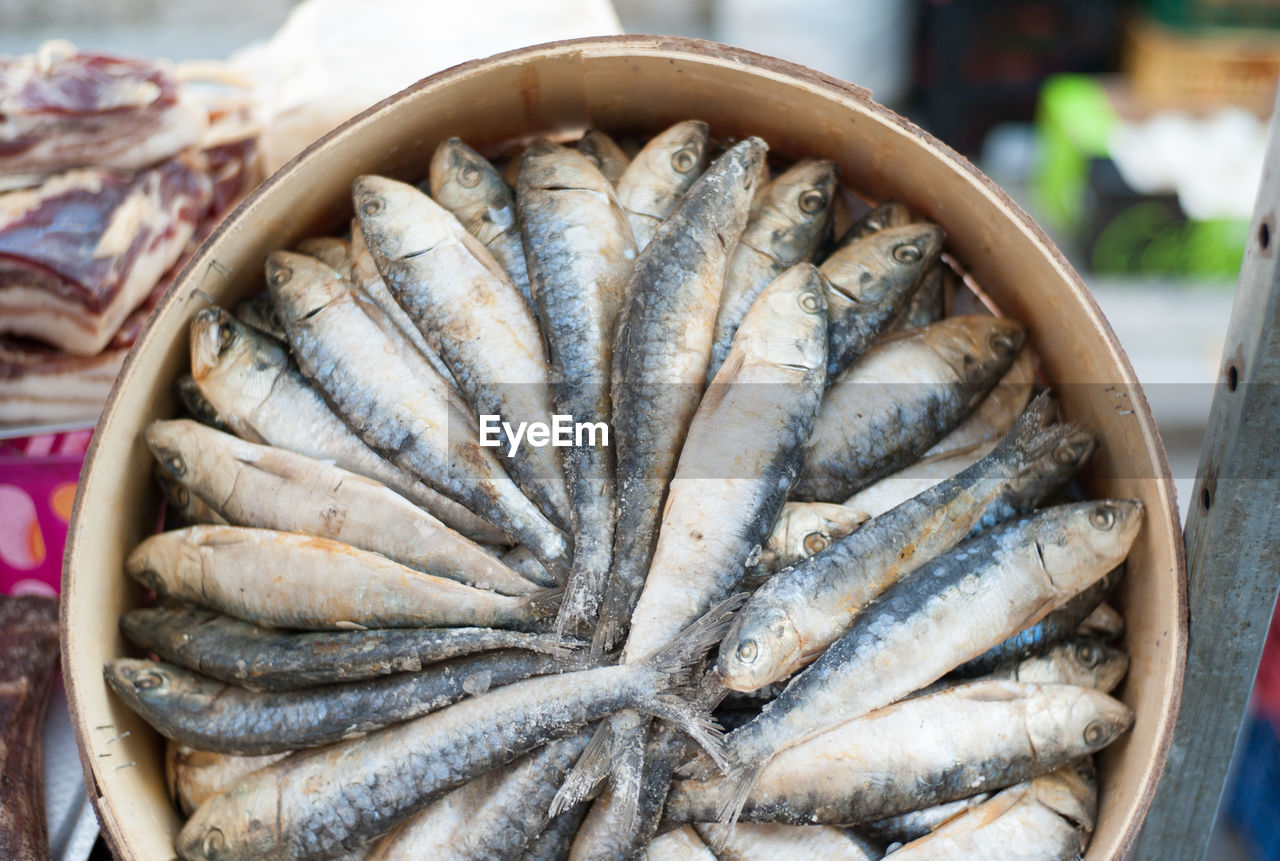 Directly above view of fish in wooden containers at market stall