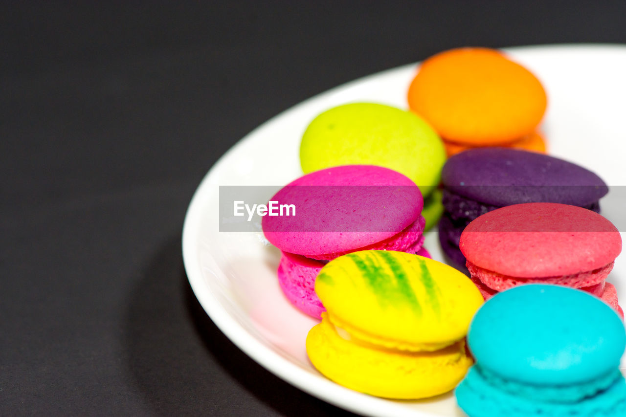 multi colored, sweet food, still life, sweet, indoors, indulgence, food, ready-to-eat, temptation, dessert, close-up, table, unhealthy eating, plate, no people, food and drink, freshness, studio shot, macaroon, candy, black background