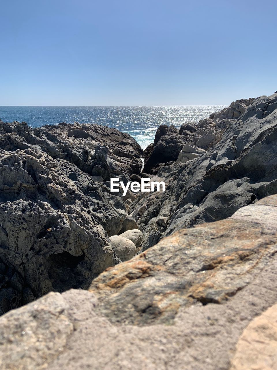 rock, sky, rock - object, solid, sea, clear sky, nature, beauty in nature, land, rock formation, no people, tranquility, scenics - nature, day, beach, water, tranquil scene, horizon, horizon over water, outdoors, rocky coastline, eroded, marine