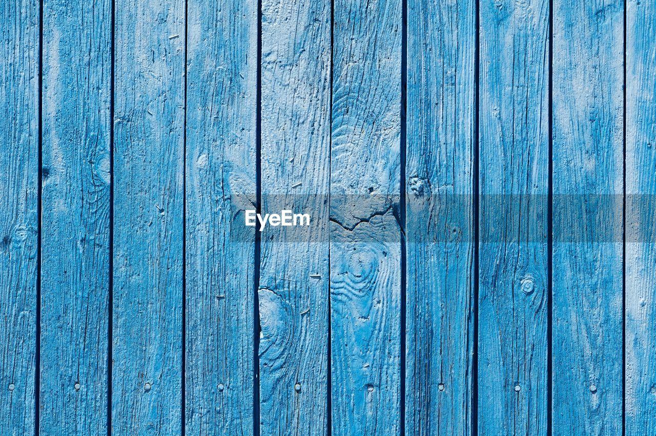 Full frame of blue wooden door