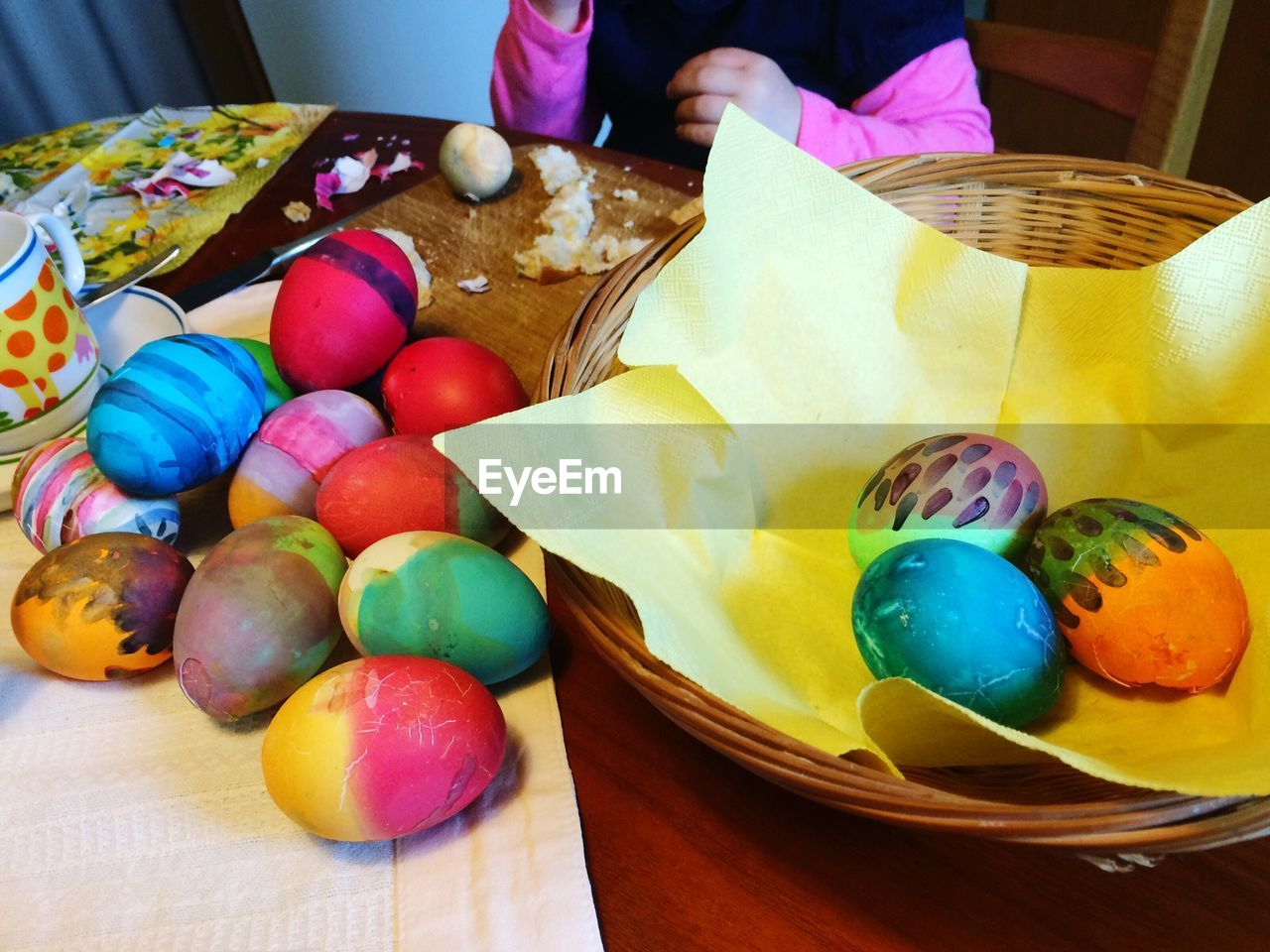 easter egg, easter, indoors, multi colored, food, egg, food and drink, table, human hand, real people, human body part, one person, freshness, close-up, day, people