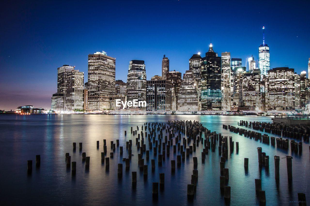 Scenic View Of Illuminated City At Dusk