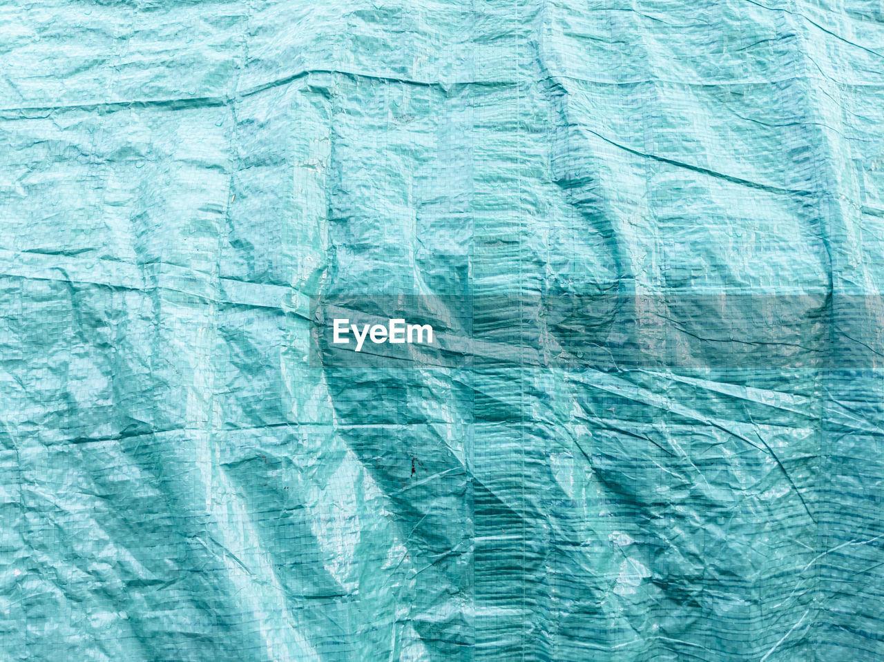 Full frame shot of blue textured tarpaulin