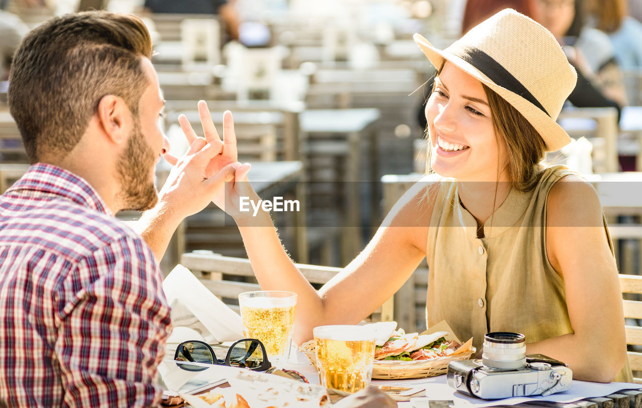 Romantic Tourist Couple Spending Leisure Time At Outdoor Restaurant