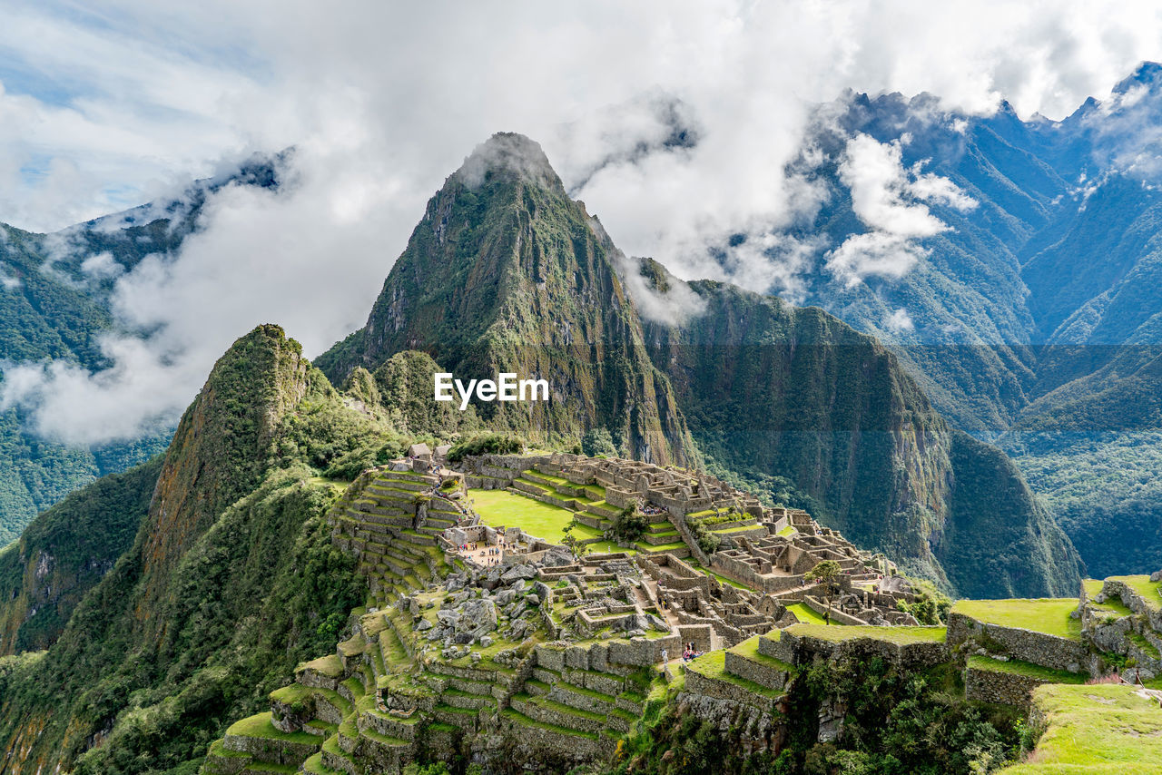 High Angle View Of Rock Formations Against Cloudy Sky At Machu Picchu