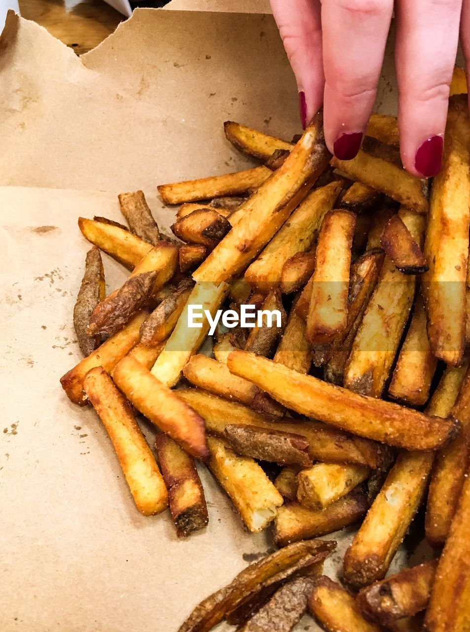 hand, human hand, food, french fries, fast food, food and drink, human body part, potato, unhealthy eating, one person, prepared potato, ready-to-eat, freshness, fried, deep fried, real people, indoors, unrecognizable person, snack, body part, finger, temptation, fast food french fries