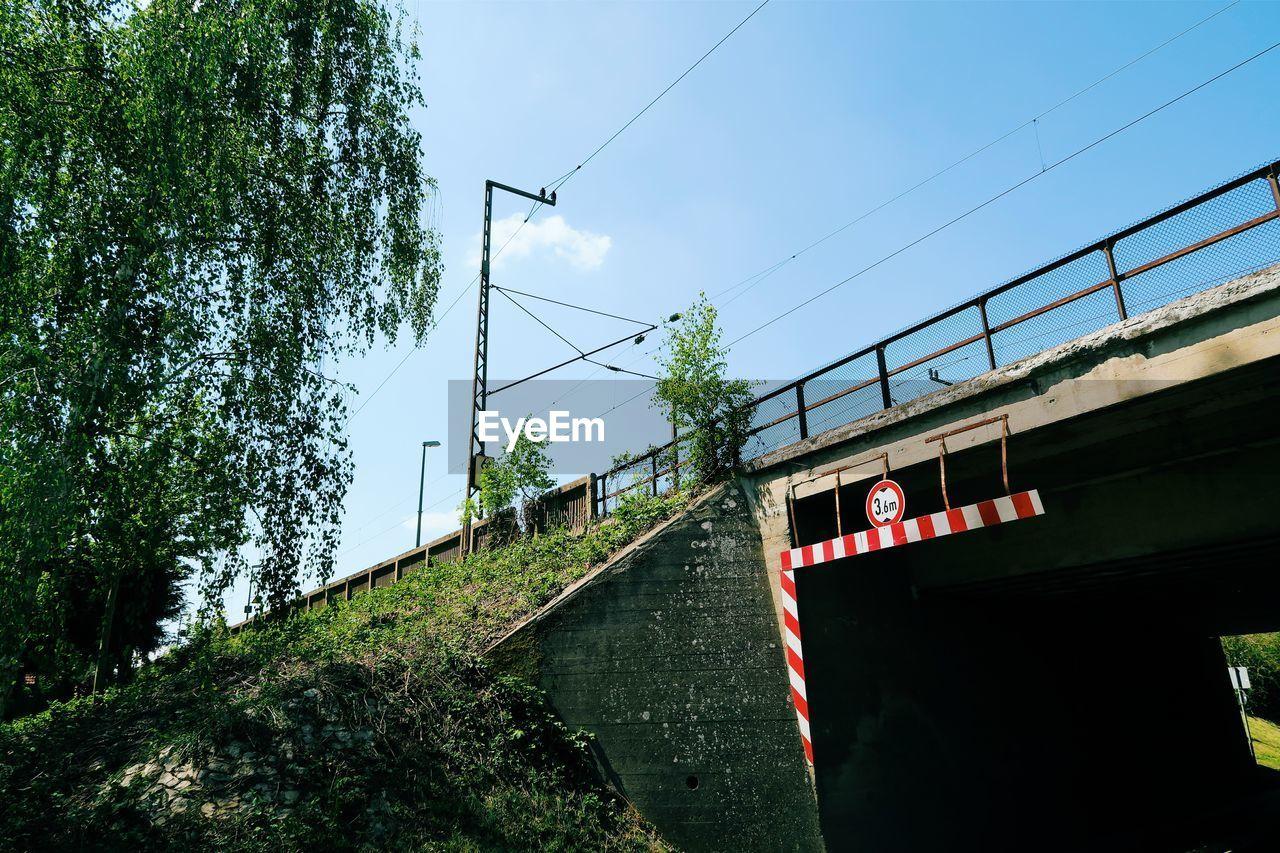Low angle view of railway bridge against sky