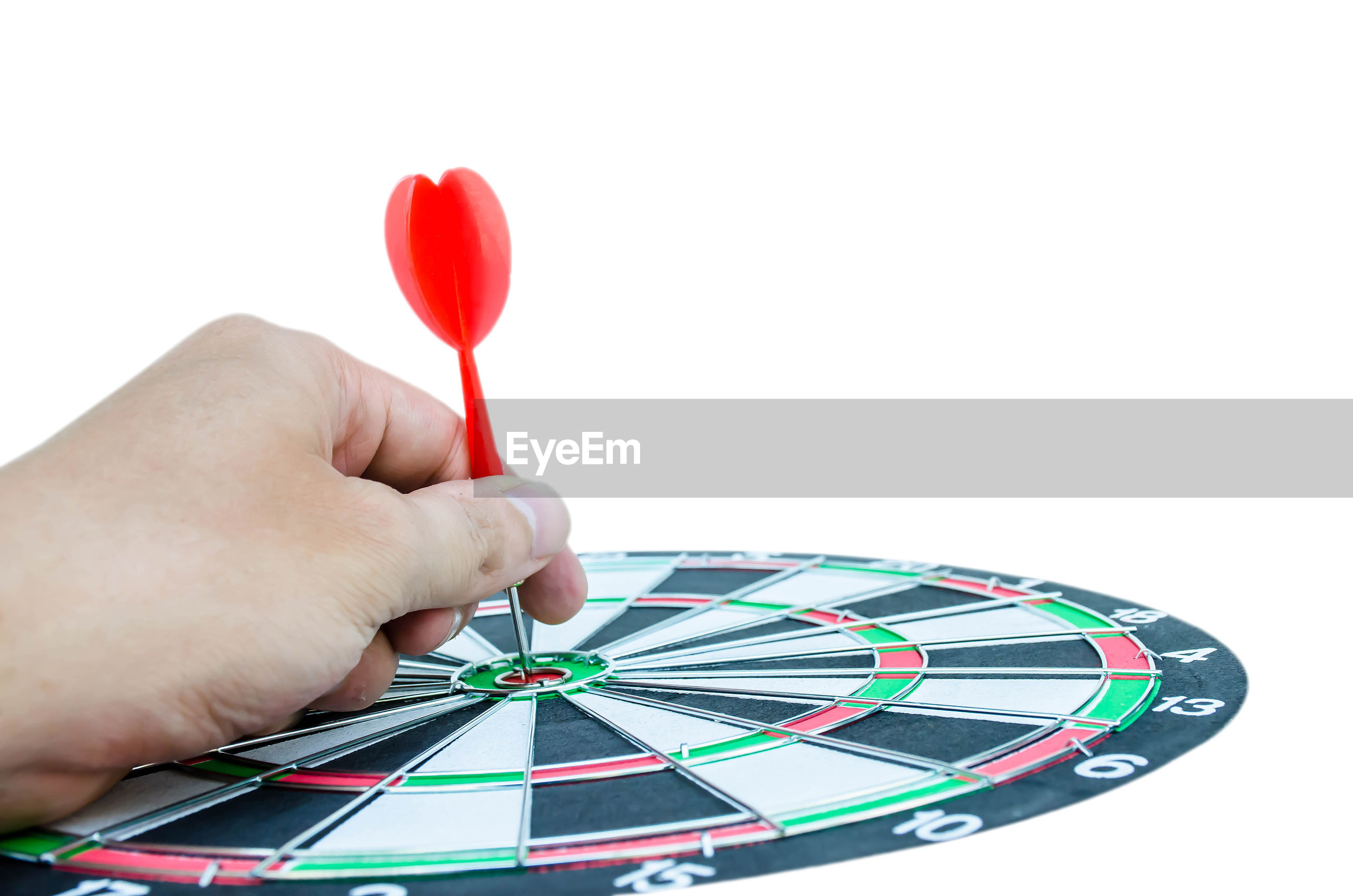 Cropped hand holding dart against white background