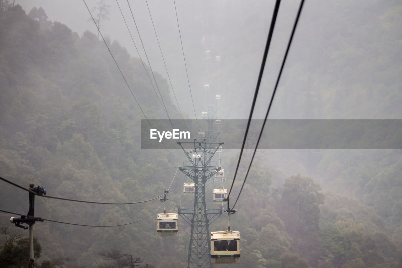 Cable cars in foggy weather