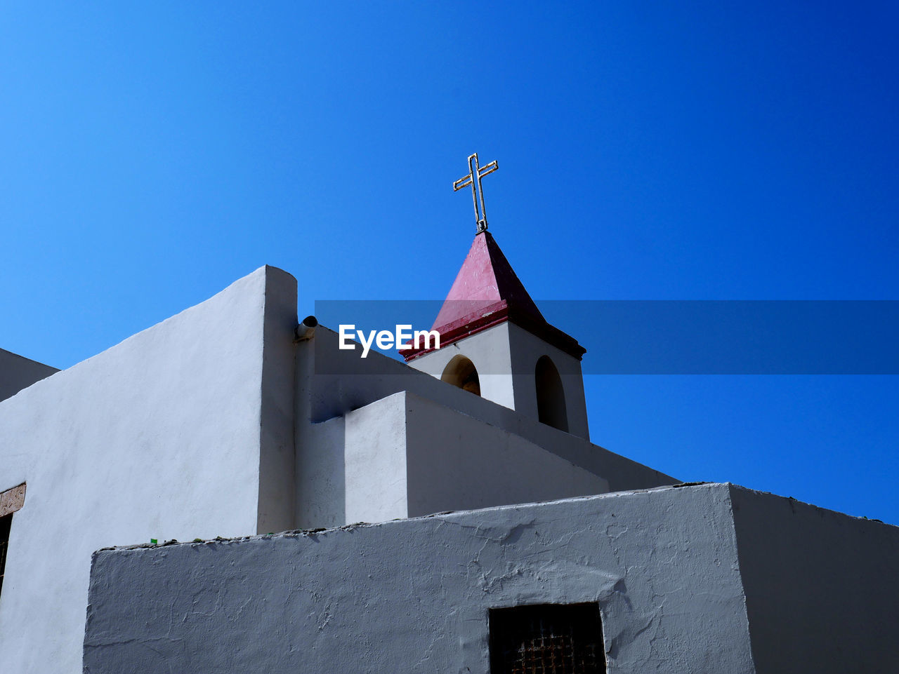 sky, architecture, built structure, low angle view, clear sky, blue, building exterior, building, no people, place of worship, religion, day, belief, nature, spirituality, copy space, flag, sunlight, outdoors