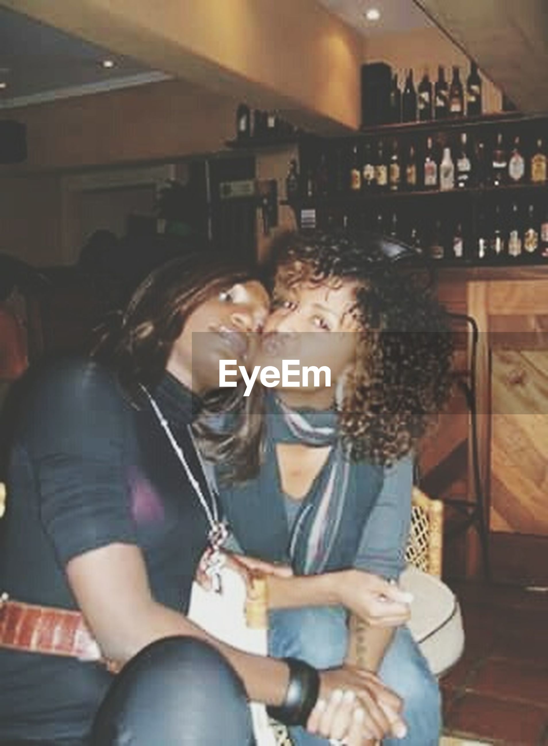 two people, young adult, adults only, young women, togetherness, smiling, arts culture and entertainment, happiness, friendship, lifestyles, bar - drink establishment, people, indoors, night, nightlife, adult, happy hour