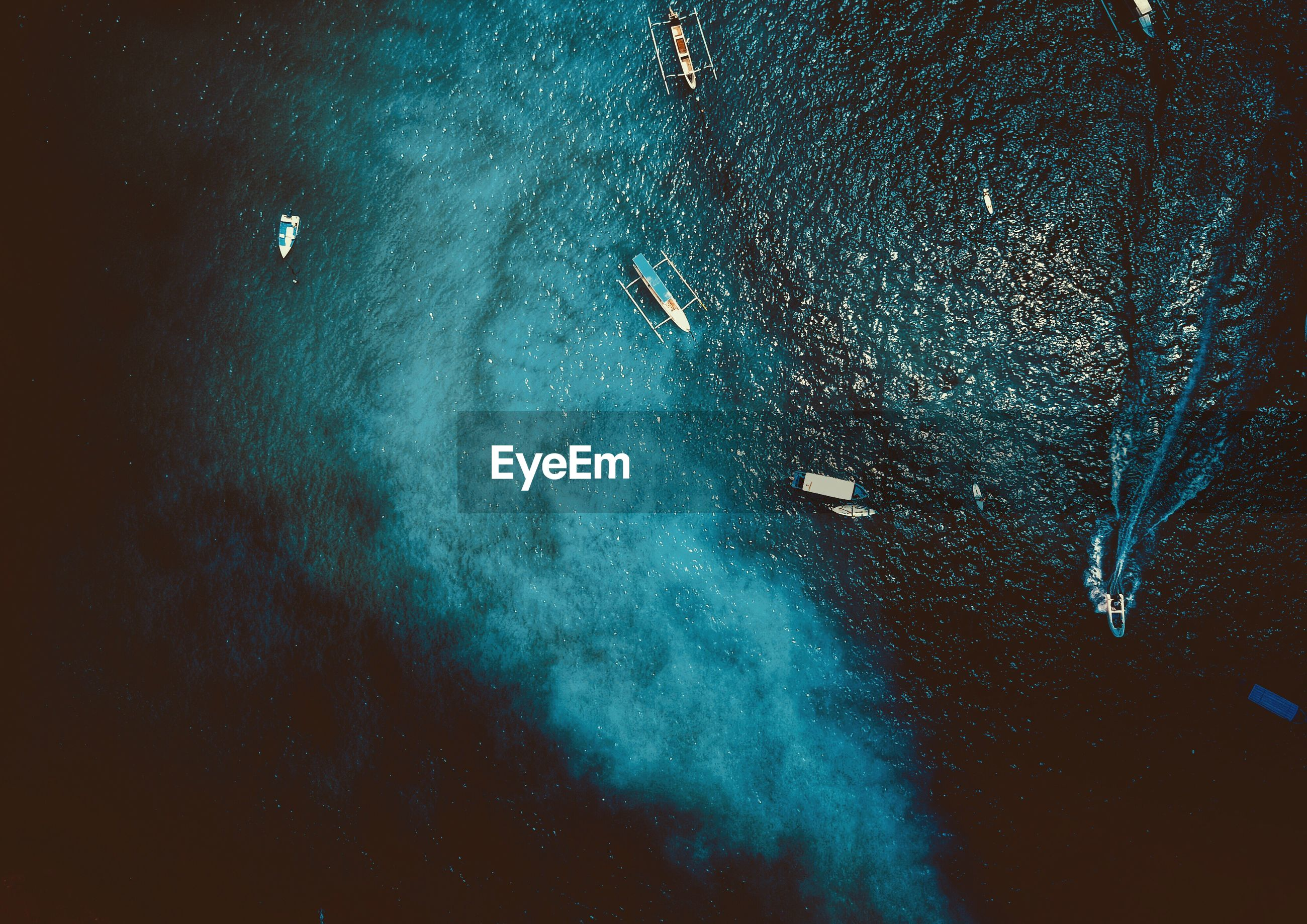 Aerial view of boats in sea at night