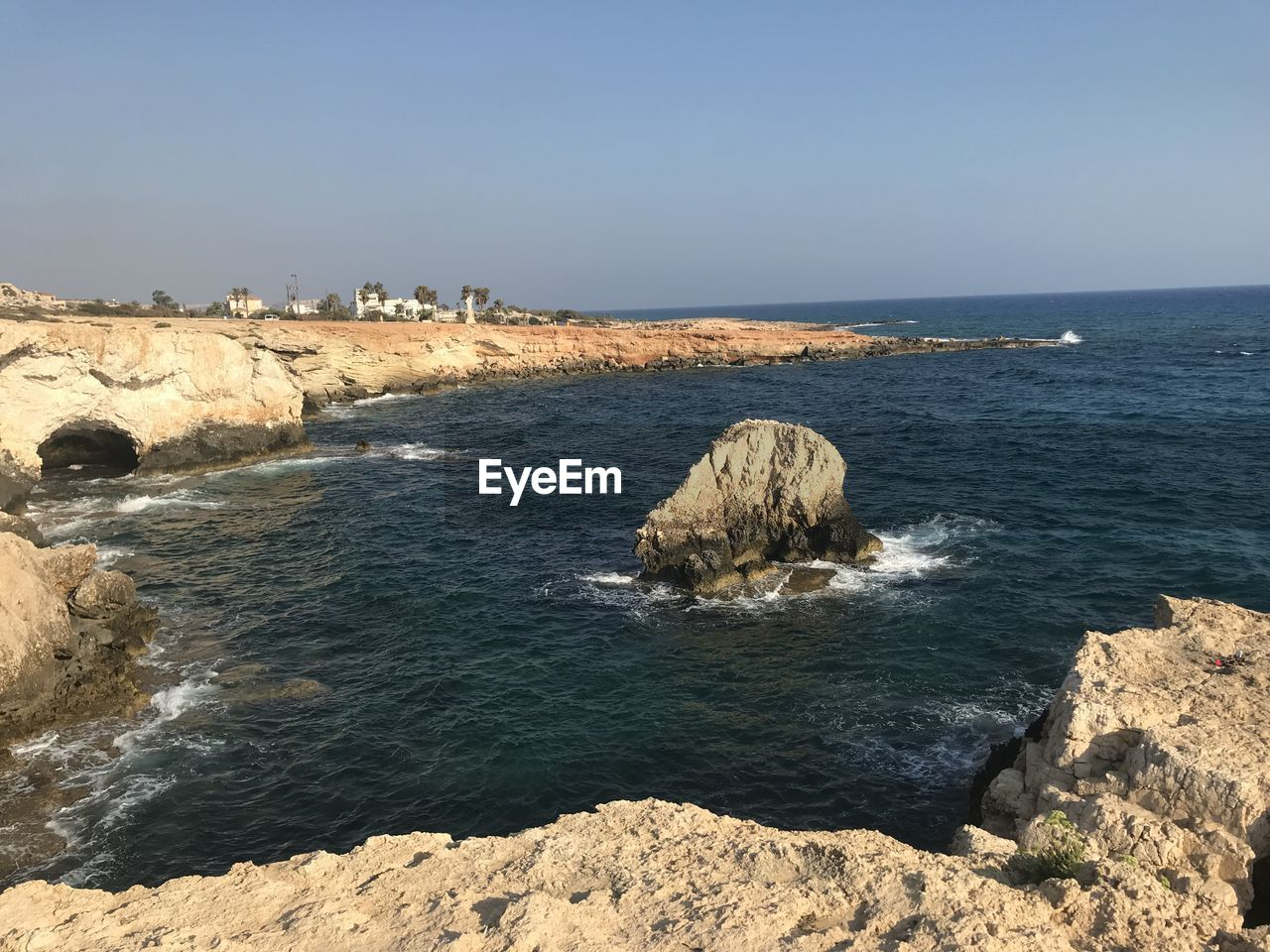 sea, water, rock, beauty in nature, sky, rock - object, scenics - nature, solid, nature, day, land, horizon, rock formation, no people, tranquility, sunlight, tranquil scene, beach, horizon over water, outdoors, stack rock