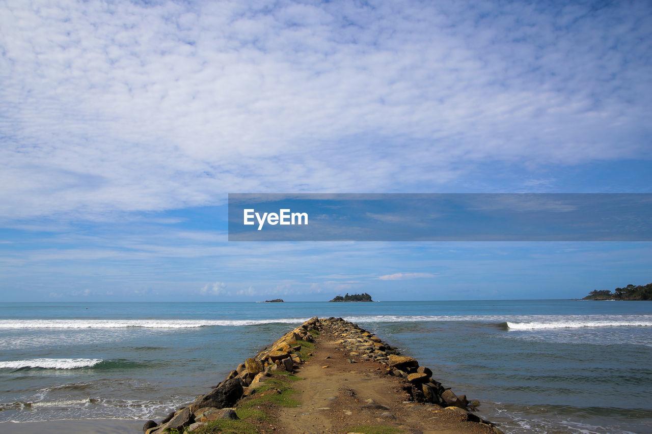 sea, water, sky, horizon, beach, land, scenics - nature, cloud - sky, horizon over water, beauty in nature, tranquil scene, tranquility, nature, motion, day, no people, wave, outdoors, rock, groyne