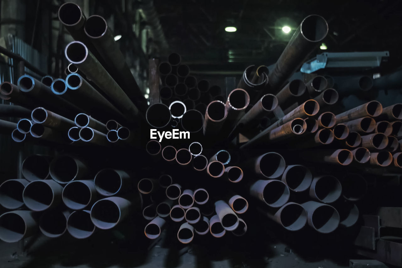 Close-up of metallic pipes in factory
