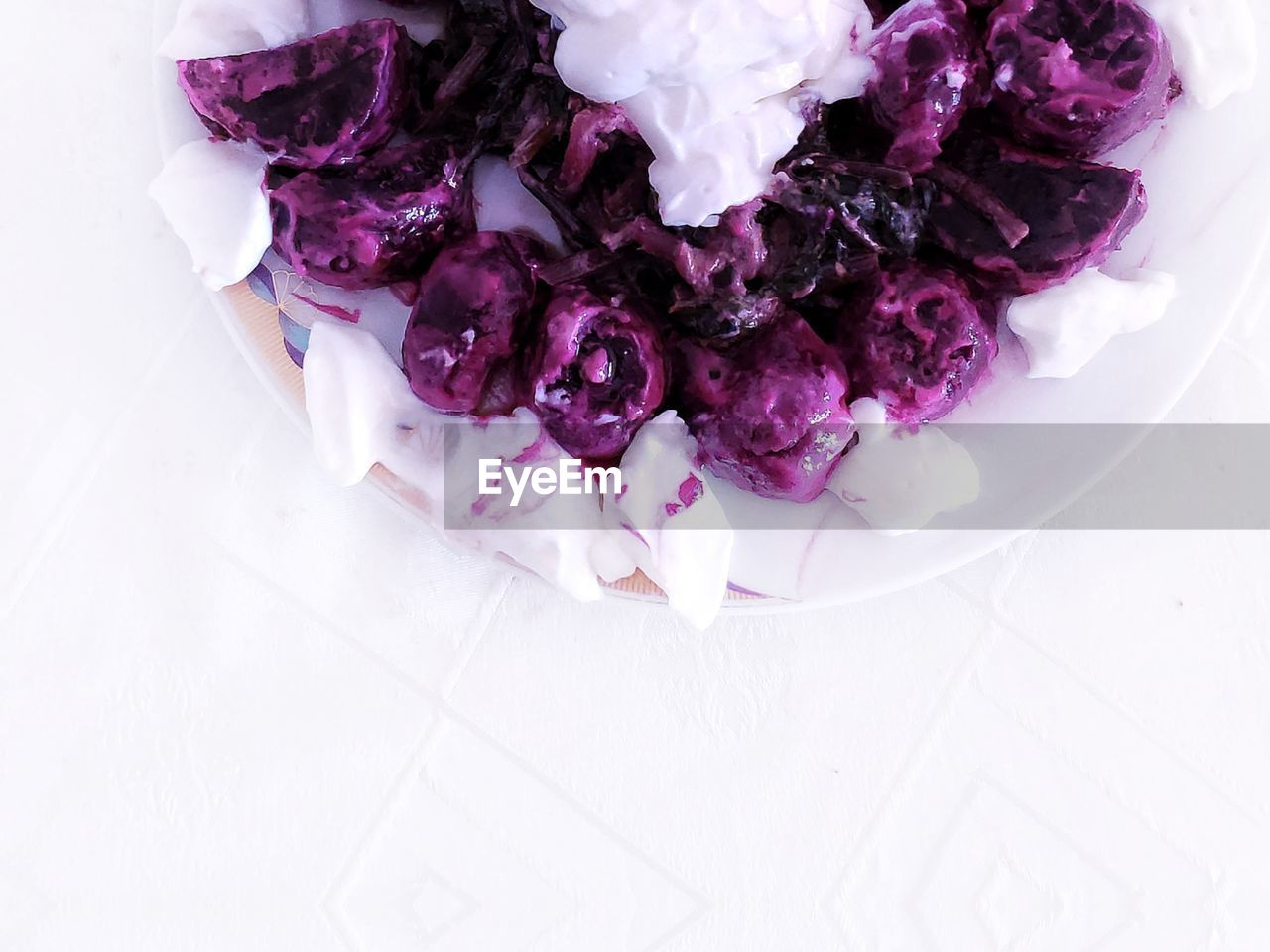 high angle view, freshness, indoors, purple, food and drink, food, white color, wellbeing, healthy eating, no people, still life, table, close-up, nature, plant, studio shot, flower, white background, directly above, plate, vegetarian food