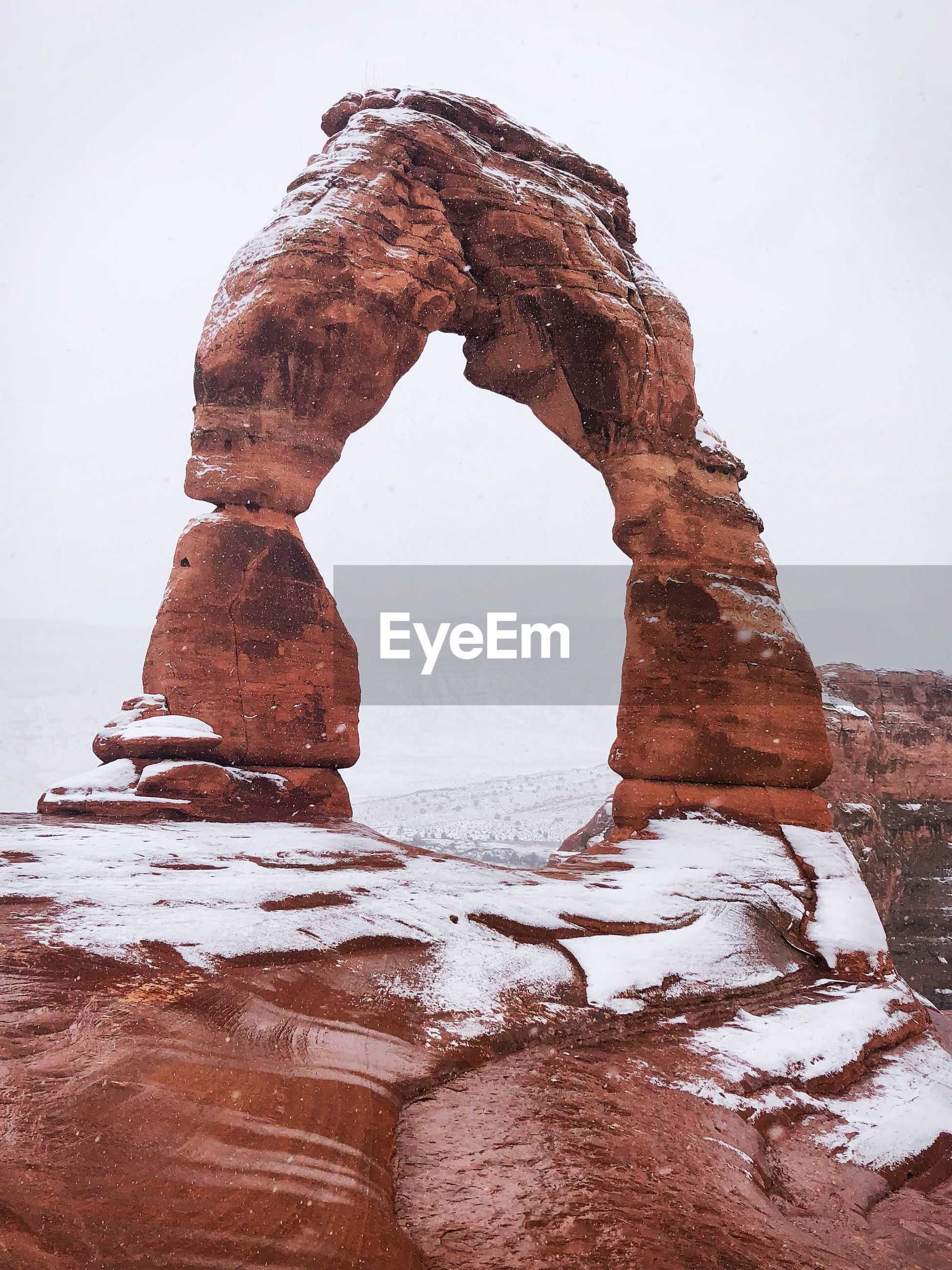 Rock formation in desert against clear sky during winter