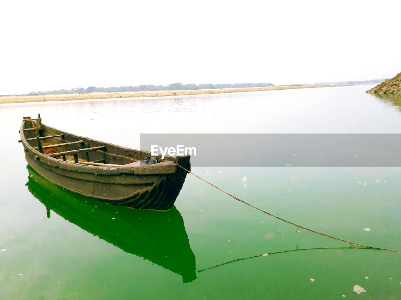 water, nautical vessel, transportation, mode of transportation, reflection, tranquility, moored, sky, nature, no people, tranquil scene, lake, day, beauty in nature, waterfront, scenics - nature, rope, clear sky, outdoors, rowboat, fishing boat