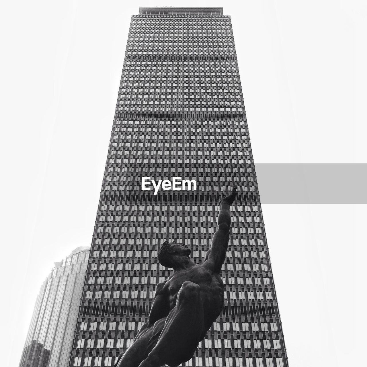 skyscraper, architecture, real people, built structure, building exterior, low angle view, one person, modern, day, human body part, outdoors, clear sky, city, sky, adult, people