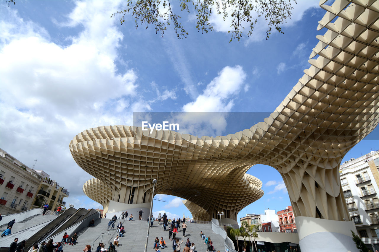 architecture, built structure, sky, cloud - sky, group of people, building exterior, large group of people, nature, day, crowd, city, travel, low angle view, real people, tourism, travel destinations, building, outdoors, incidental people