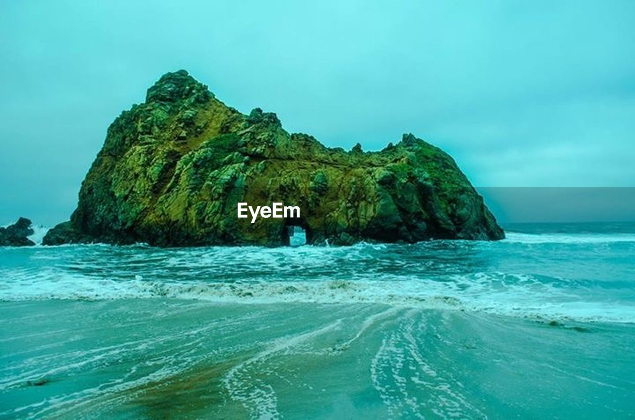 sea, rock - object, rock formation, nature, beauty in nature, water, scenics, beach, cliff, horizon over water, tranquility, natural arch, day, outdoors, wave, no people, sky