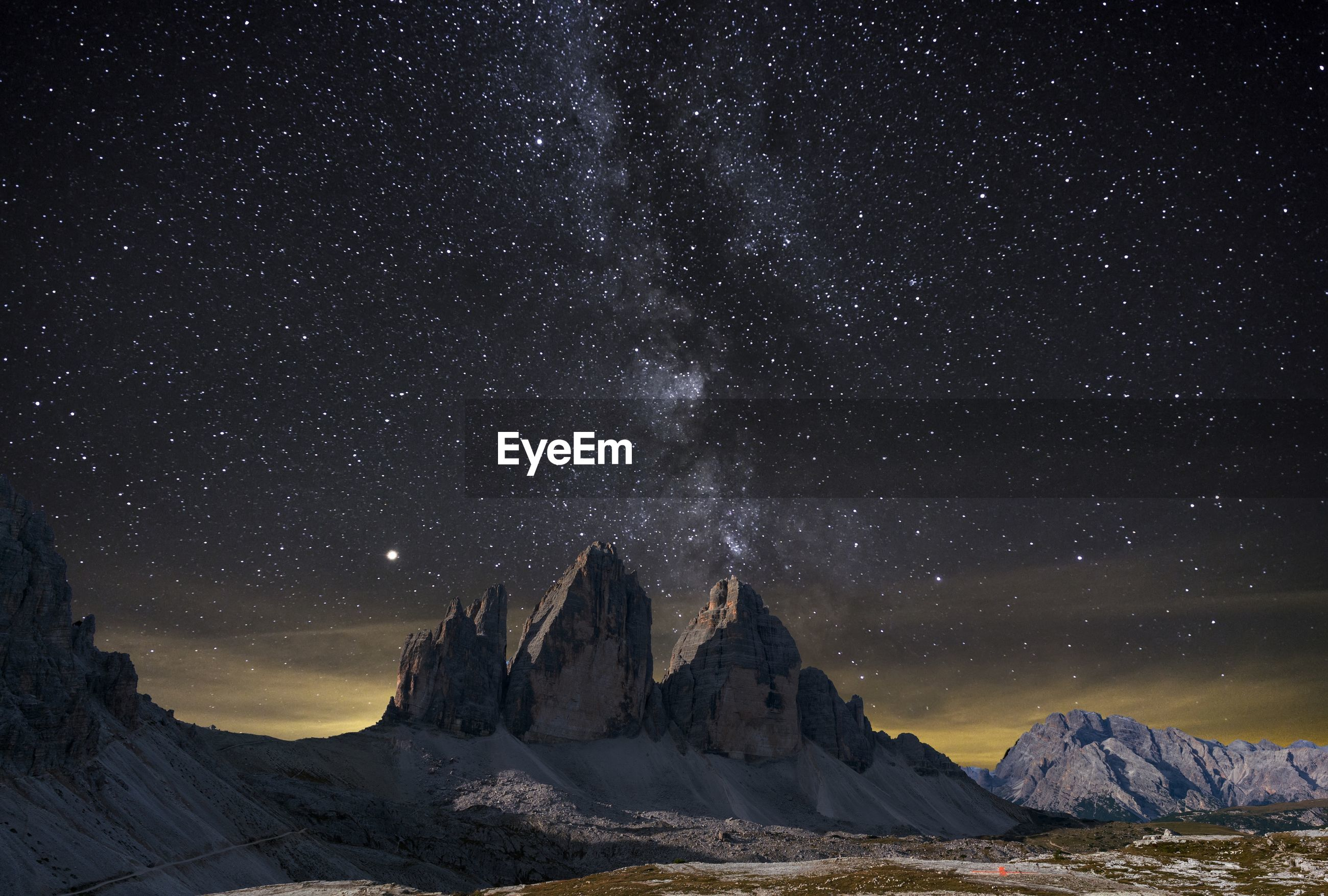 Scenic view of rocky mountains against star field
