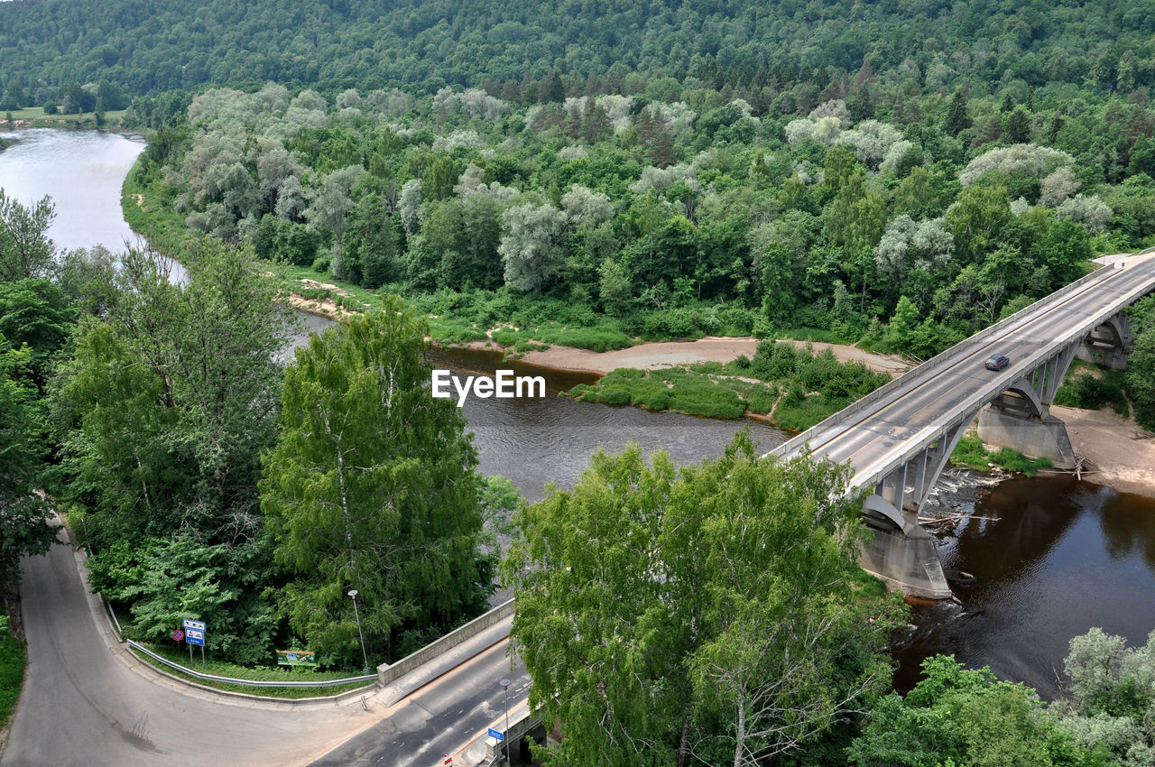 plant, tree, transportation, water, mode of transportation, day, nature, high angle view, growth, road, public transportation, built structure, beauty in nature, motor vehicle, scenics - nature, river, architecture, outdoors, car, no people