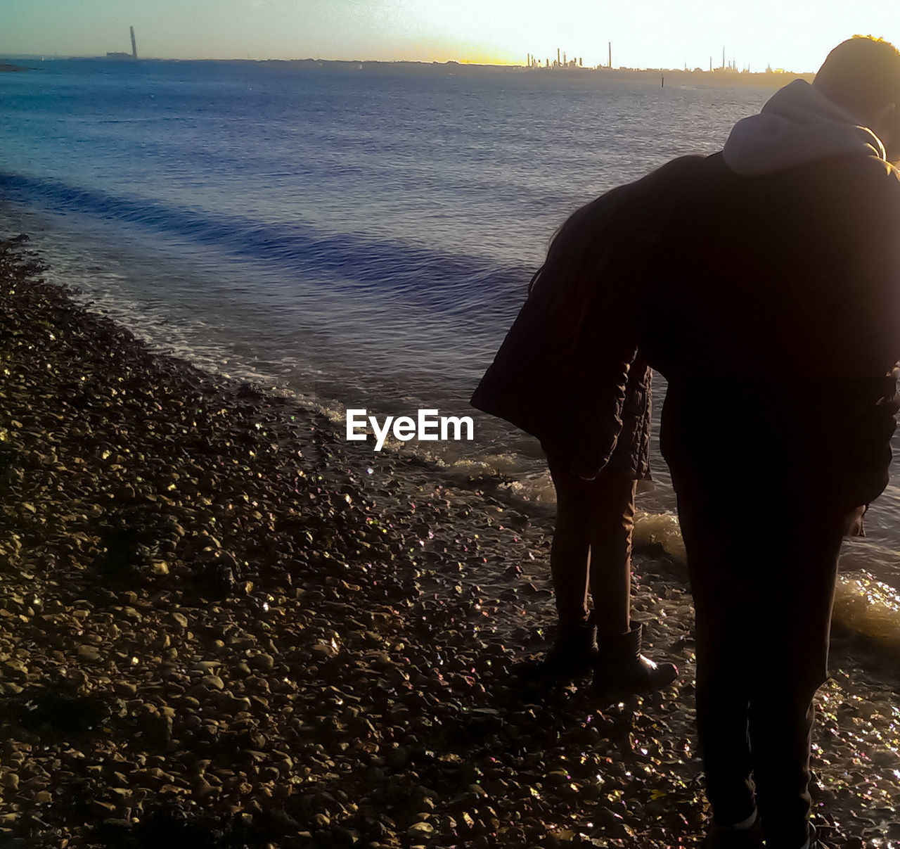 sea, real people, water, standing, nature, men, rear view, horizon over water, two people, togetherness, love, beauty in nature, scenics, lifestyles, leisure activity, beach, women, day, full length, outdoors, sky, people