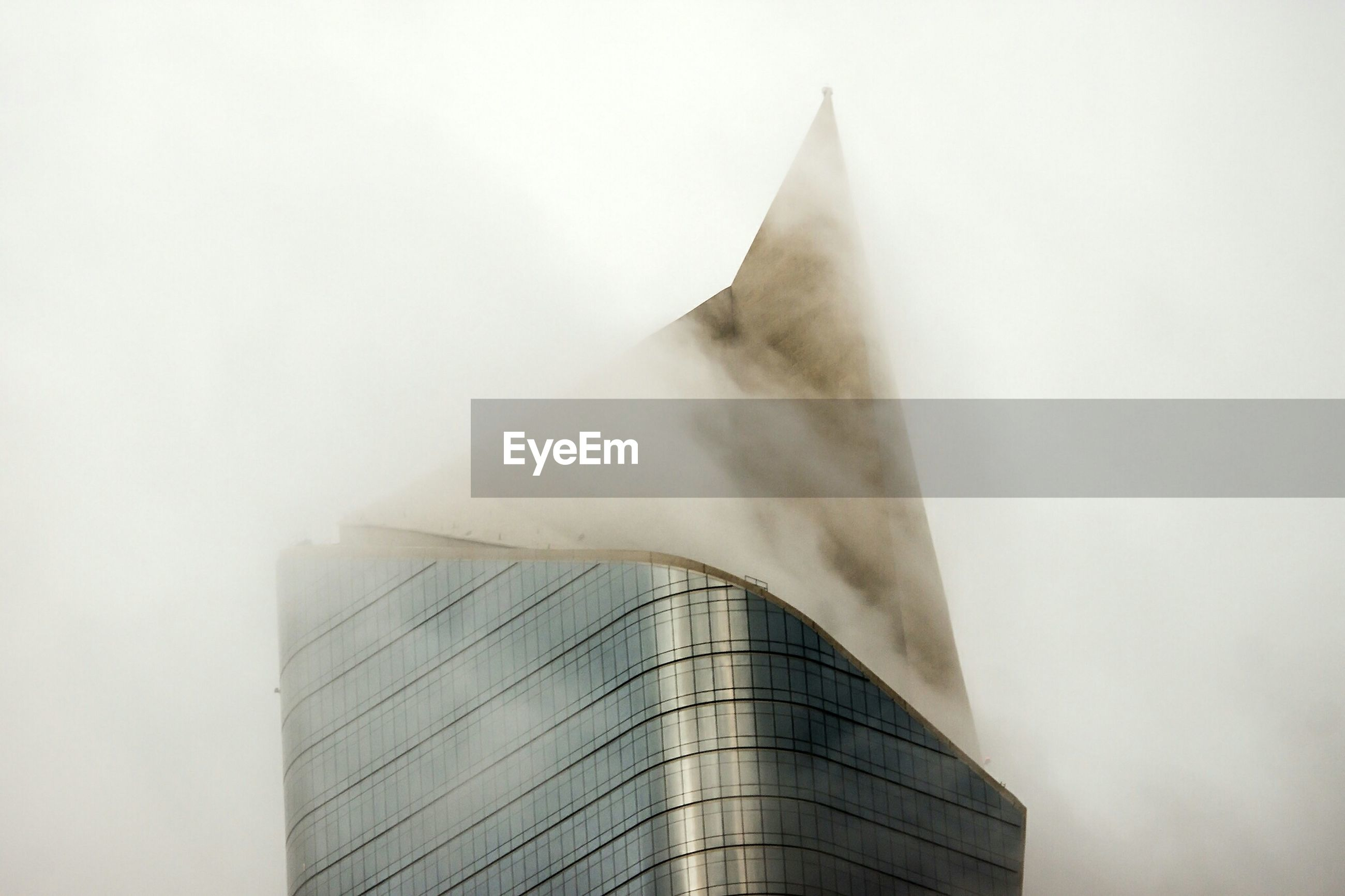 Exterior of modern building covered with fog