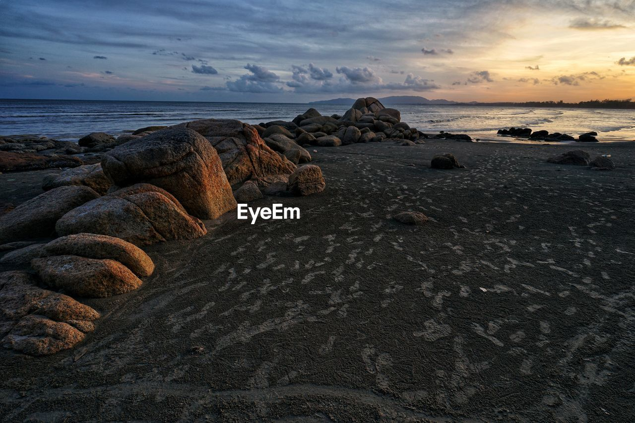 sky, rock, sea, rock - object, water, solid, cloud - sky, scenics - nature, beauty in nature, sunset, tranquility, tranquil scene, horizon over water, land, beach, horizon, nature, no people, non-urban scene, rocky coastline