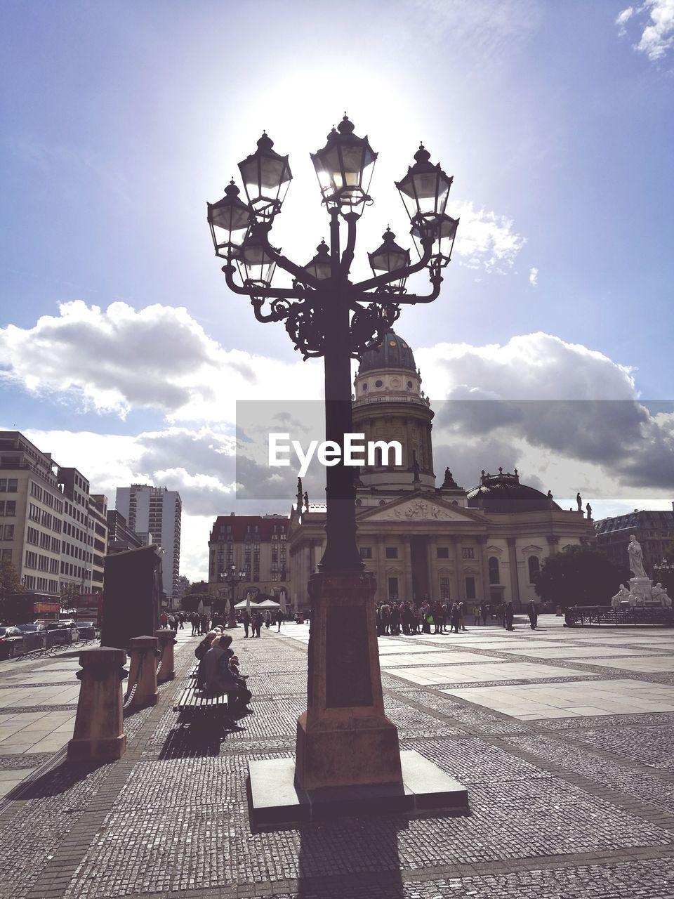 sky, cloud - sky, outdoors, sunlight, building exterior, architecture, built structure, day, sculpture, statue, street light, travel destinations, city, no people, tree