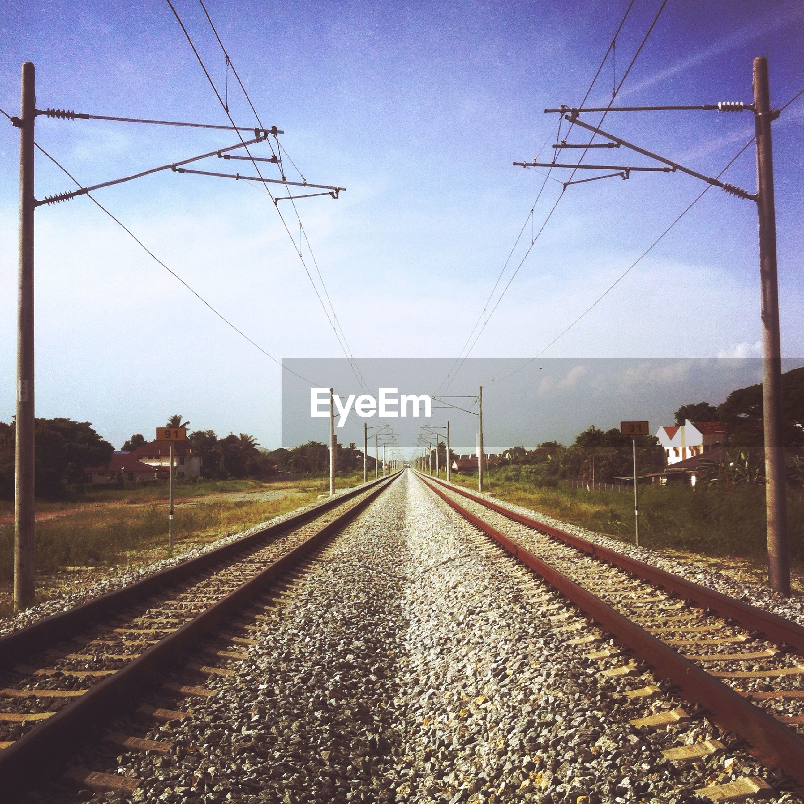 power line, electricity pylon, railroad track, the way forward, diminishing perspective, sky, electricity, vanishing point, transportation, rail transportation, power supply, cable, connection, long, fuel and power generation, outdoors, power cable, no people, day, railway track