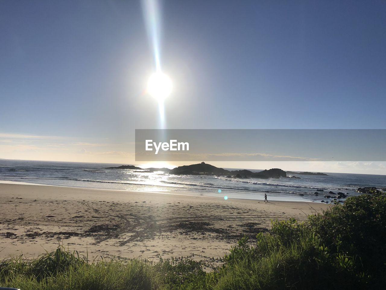 water, sky, sea, beach, beauty in nature, land, scenics - nature, tranquil scene, tranquility, nature, sun, horizon, horizon over water, sunlight, no people, non-urban scene, idyllic, sunbeam, sand, outdoors, lens flare