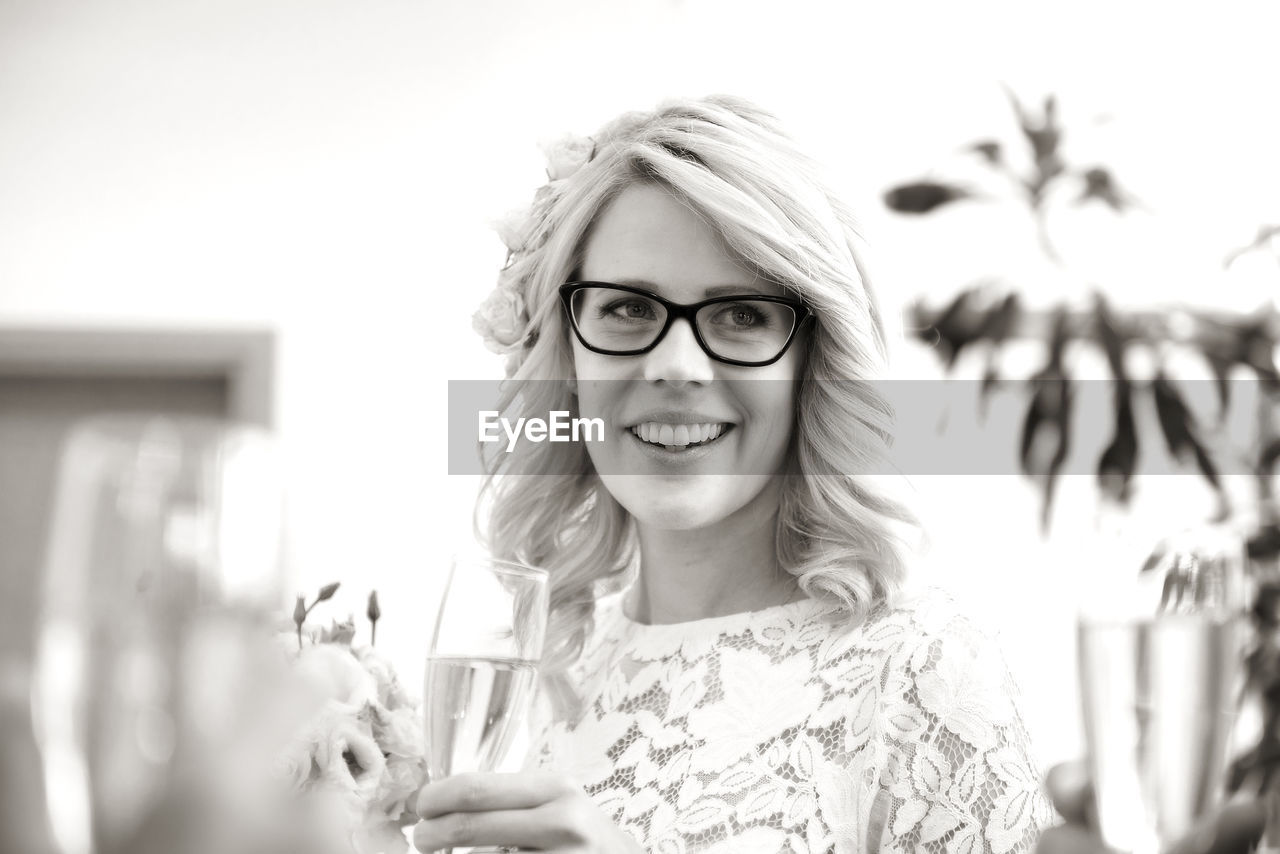 Portrait Of Young Woman Wearing Eyeglasses Against Sky