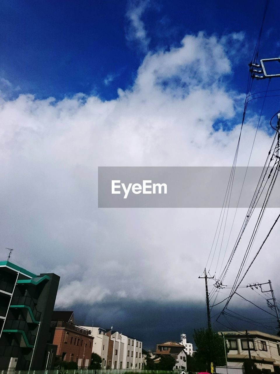 sky, cloud - sky, building exterior, architecture, outdoors, built structure, cable, low angle view, no people, day, nature