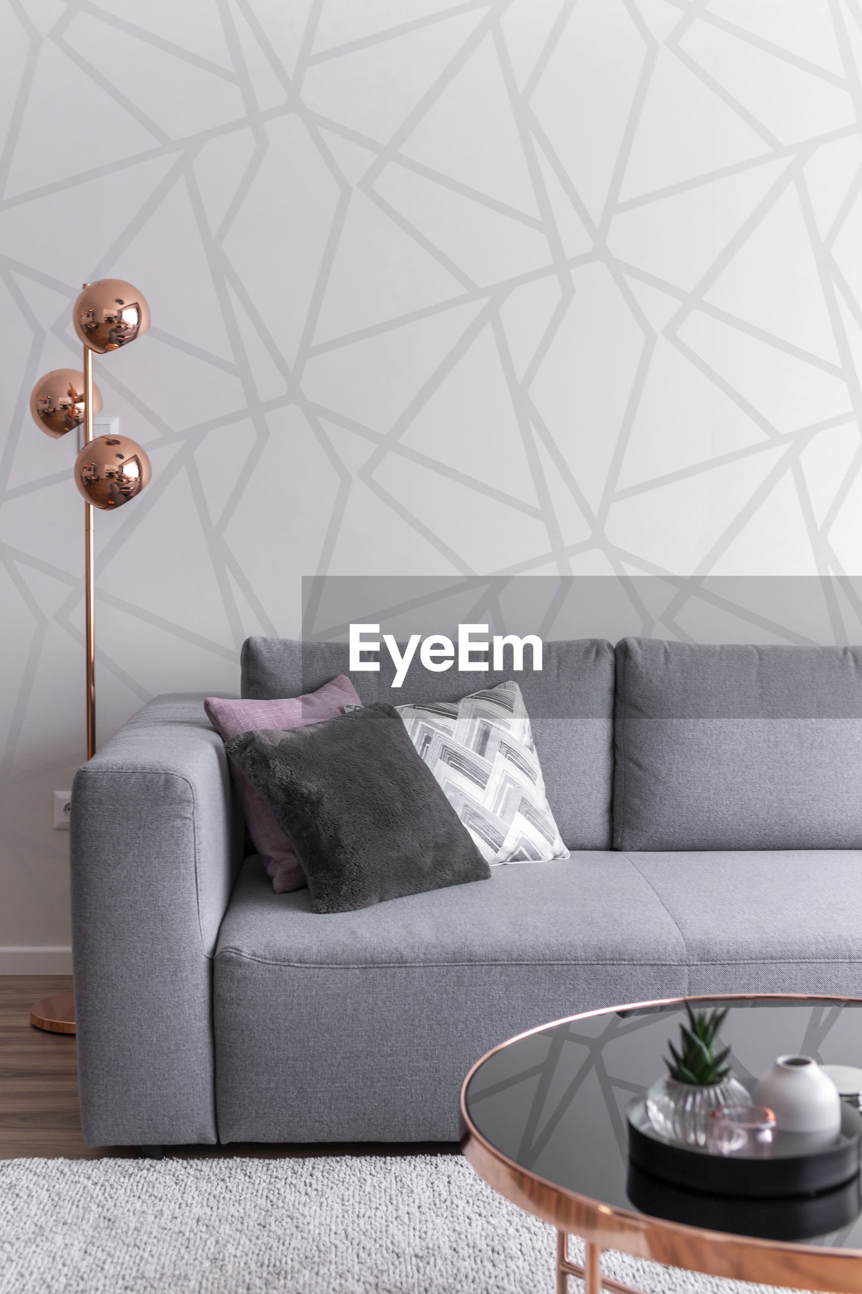 ELECTRIC LAMP ON SOFA AT TABLE