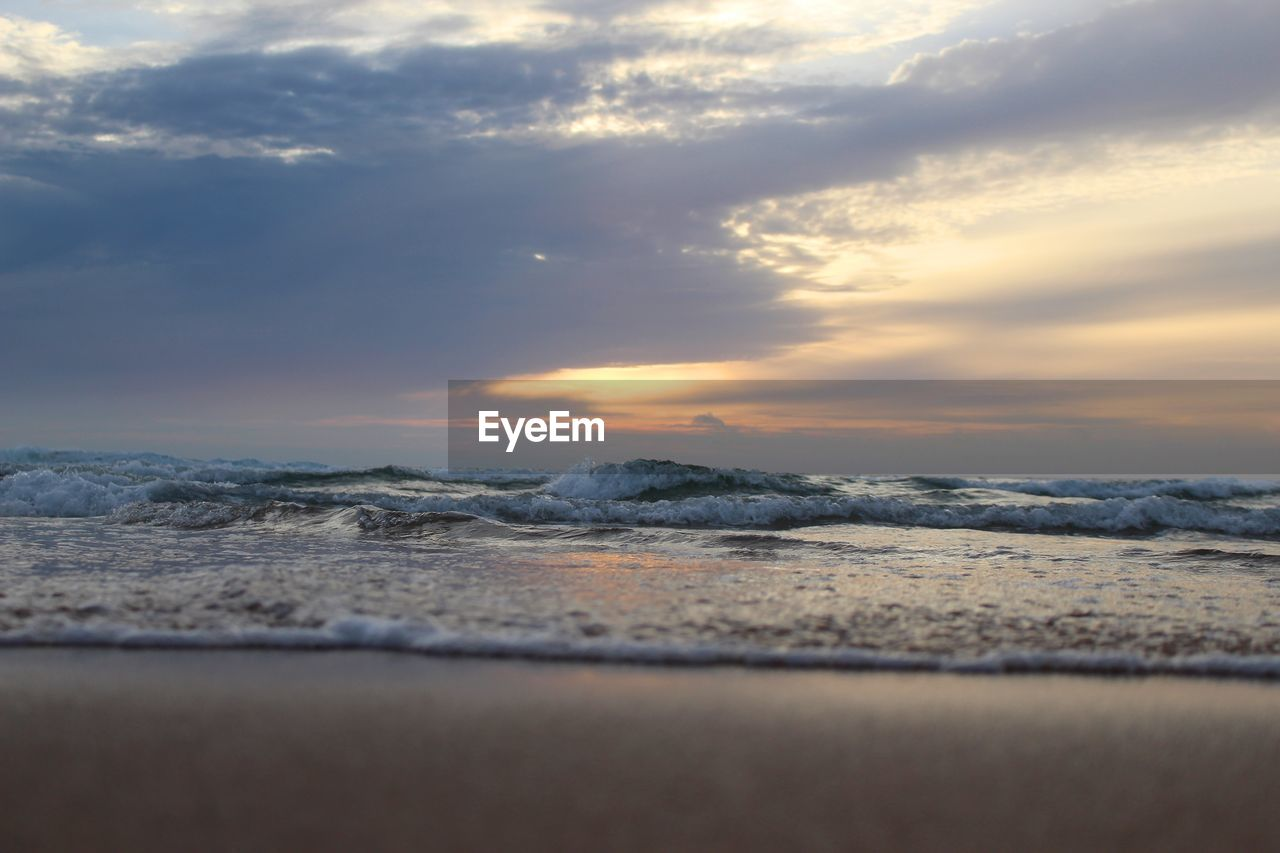 sunset, nature, beauty in nature, sea, sky, scenics, cloud - sky, tranquility, no people, outdoors, wave, tranquil scene, water, beach, day