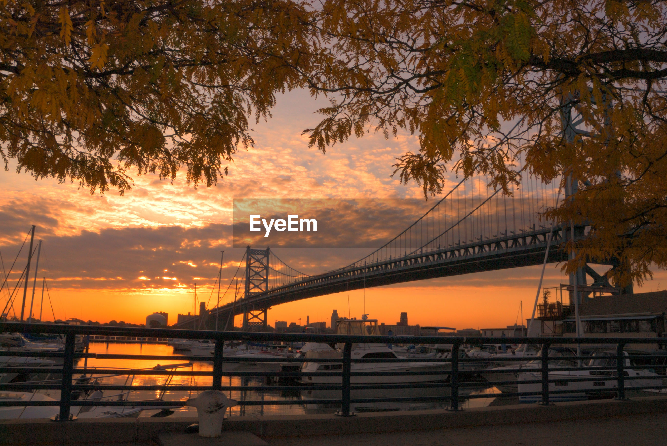 VIEW OF SUSPENSION BRIDGE DURING SUNSET