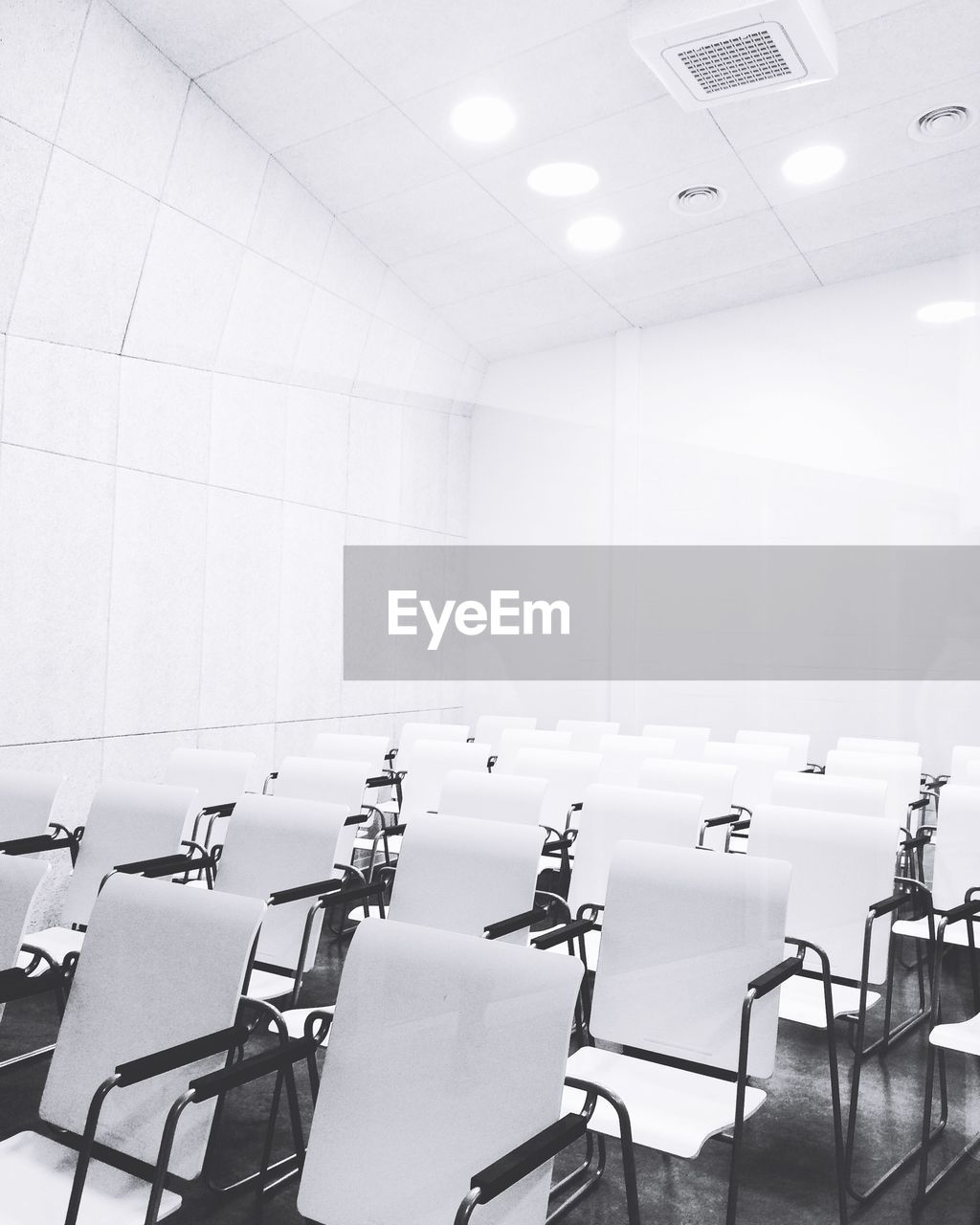 indoors, seat, empty, chair, absence, table, school, education, no people, in a row, classroom, business, learning, office, desk, university, illuminated, ceiling, architecture