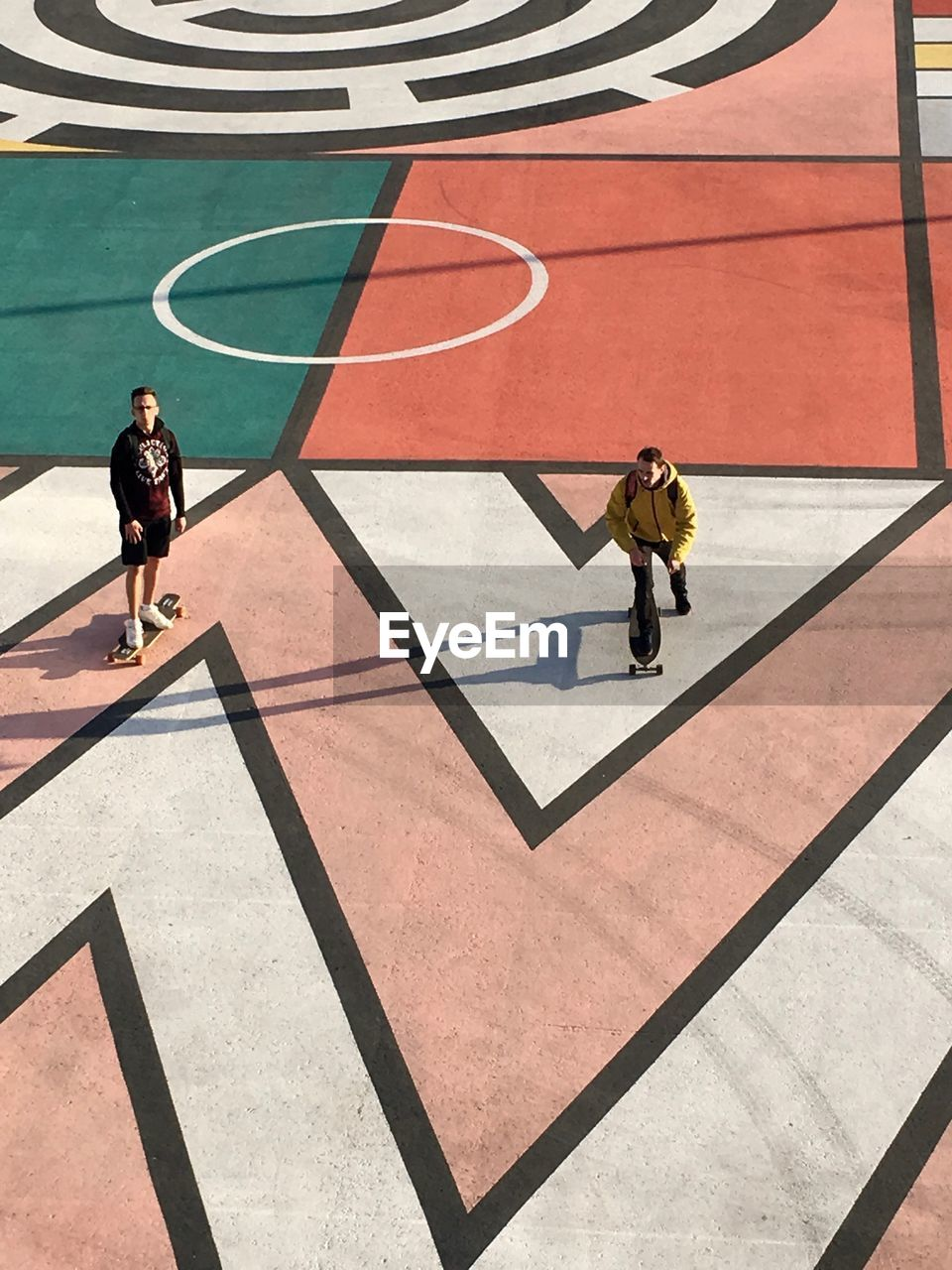 real people, high angle view, full length, shadow, sunlight, day, men, lifestyles, outdoors, court, one person, basketball - sport, adult, people