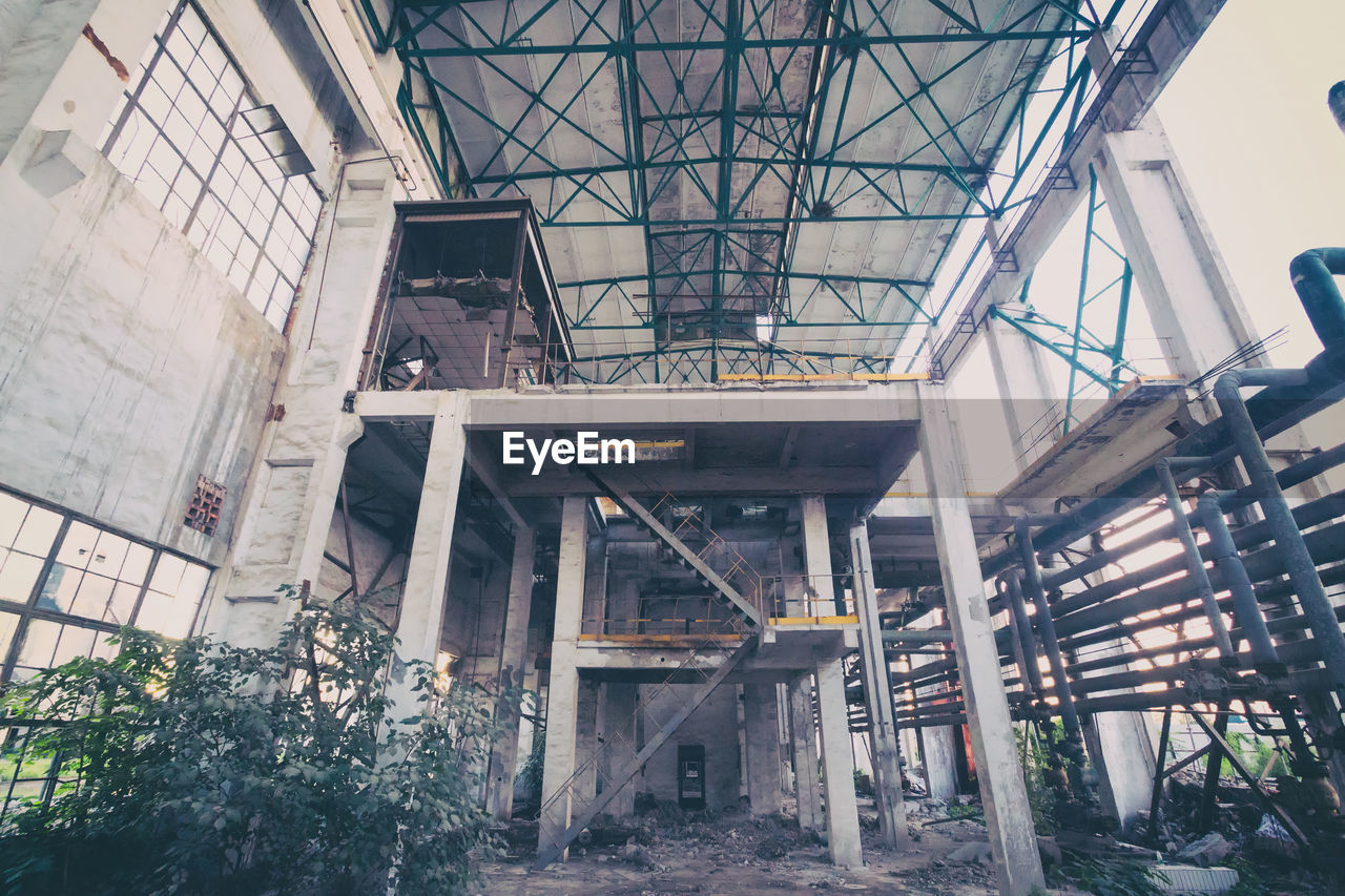 LOW ANGLE VIEW OF ABANDONED FACTORY