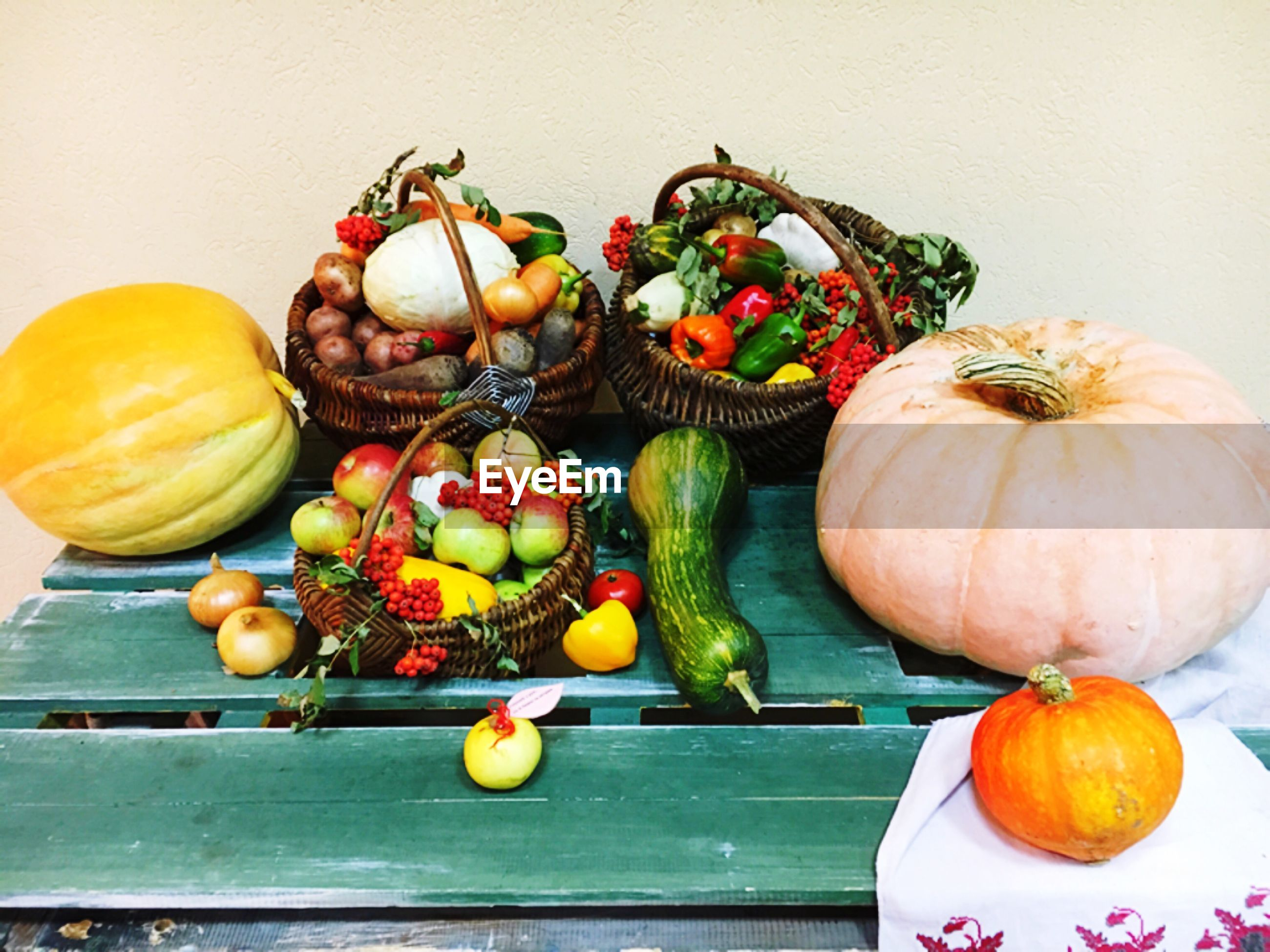 High angle view of fruits and pumpkins on table